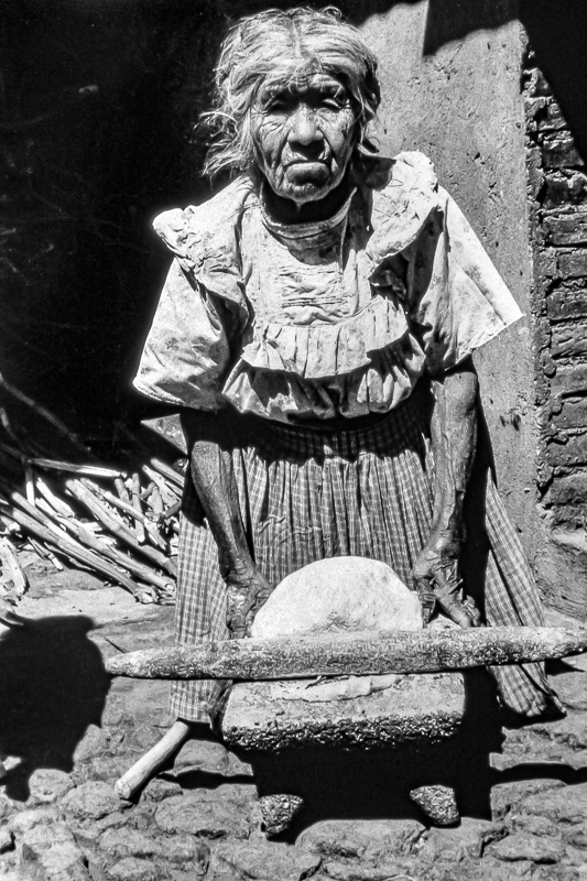 Woman with Mano and Metate, Canoa