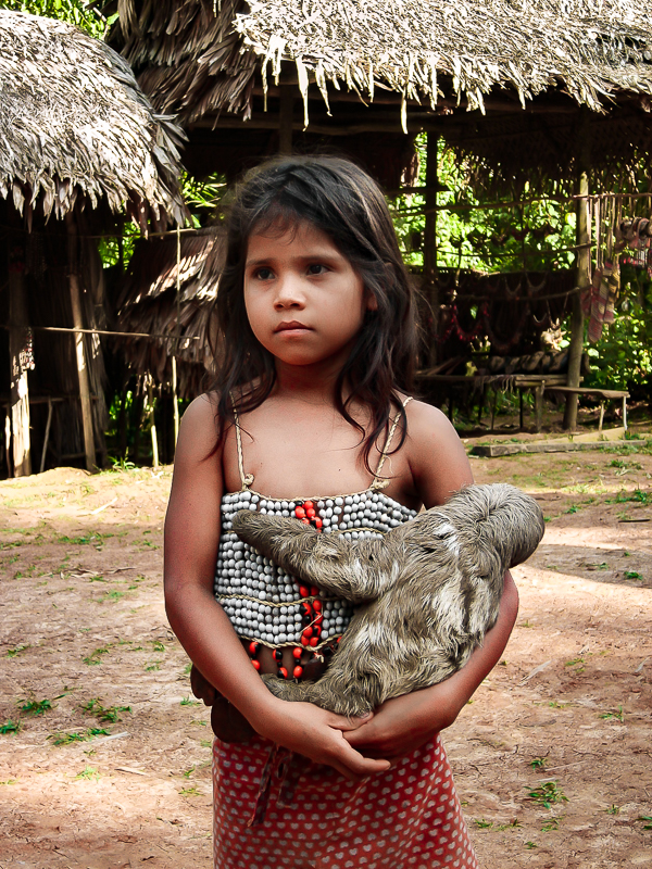 Little Girl with Sloth in the Amazon, Peru