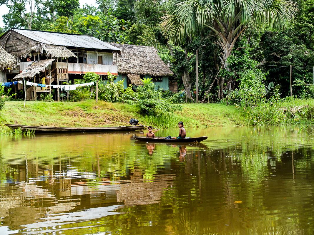 Boys in a Canoe in the Amazon, Peru