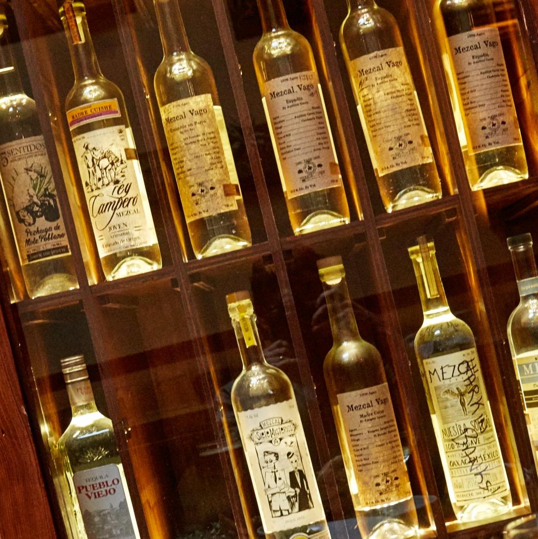 Mezcal bottles in Locker