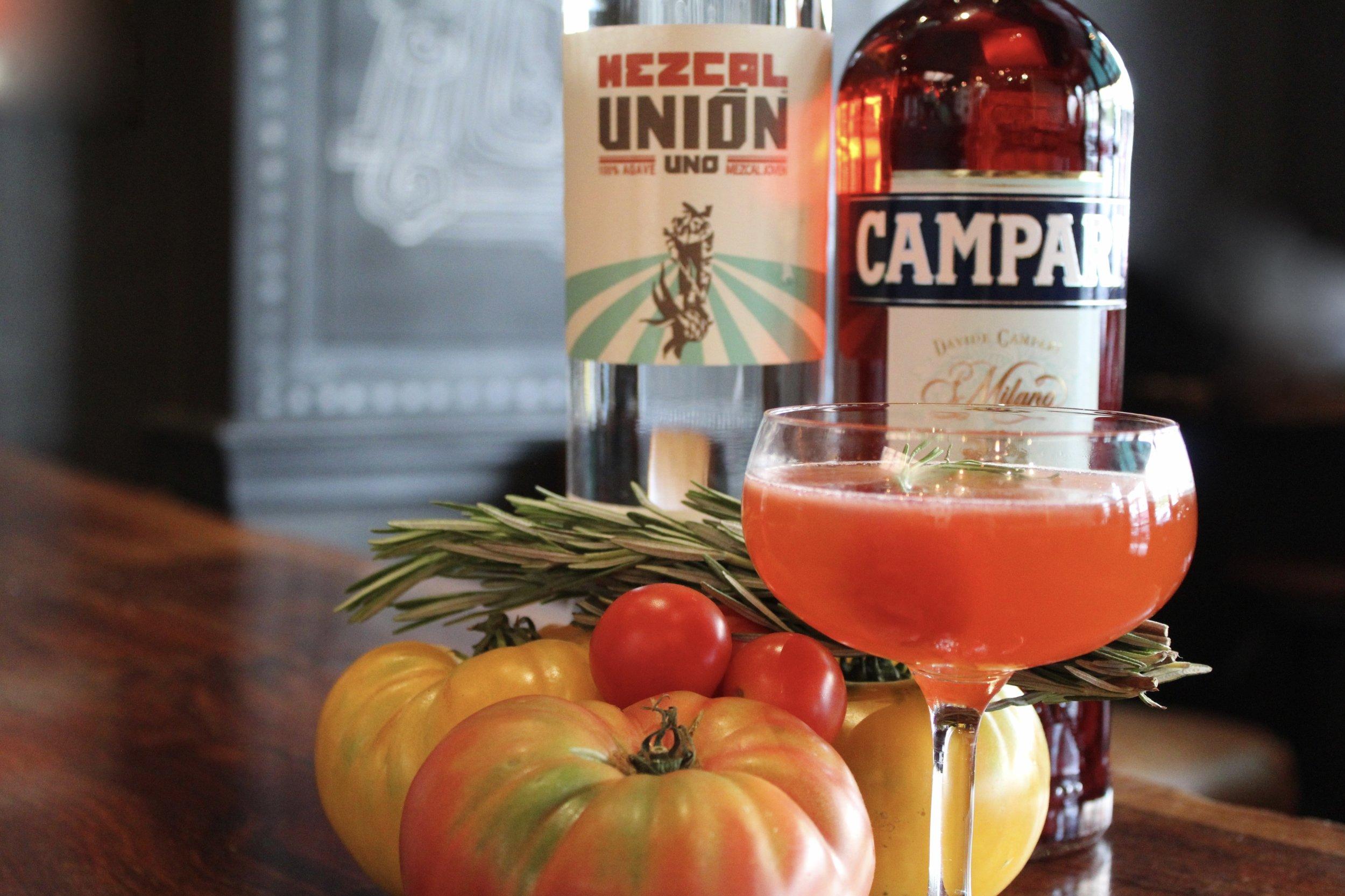 Cocktail and bottles of mezcal
