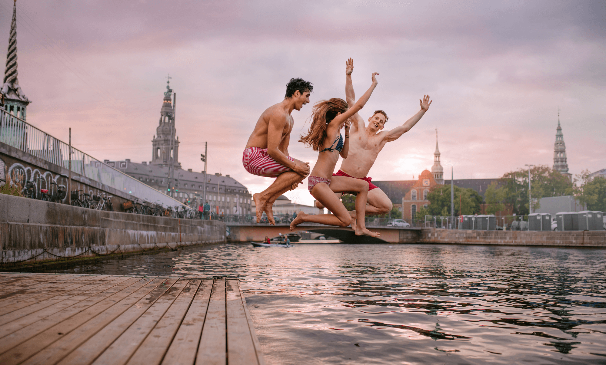 Canva---People-Jumping-into-Lake (1).png