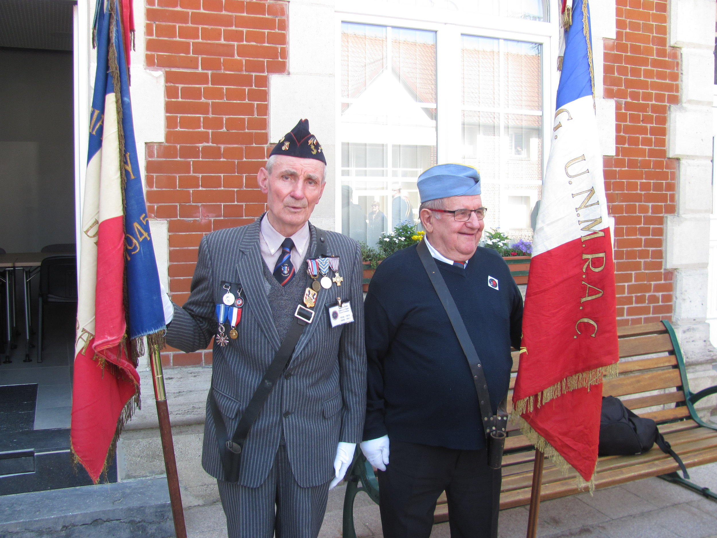 Portes drapeux - flag carriers from Thelus Veterens' Associations participate in the ceremony.