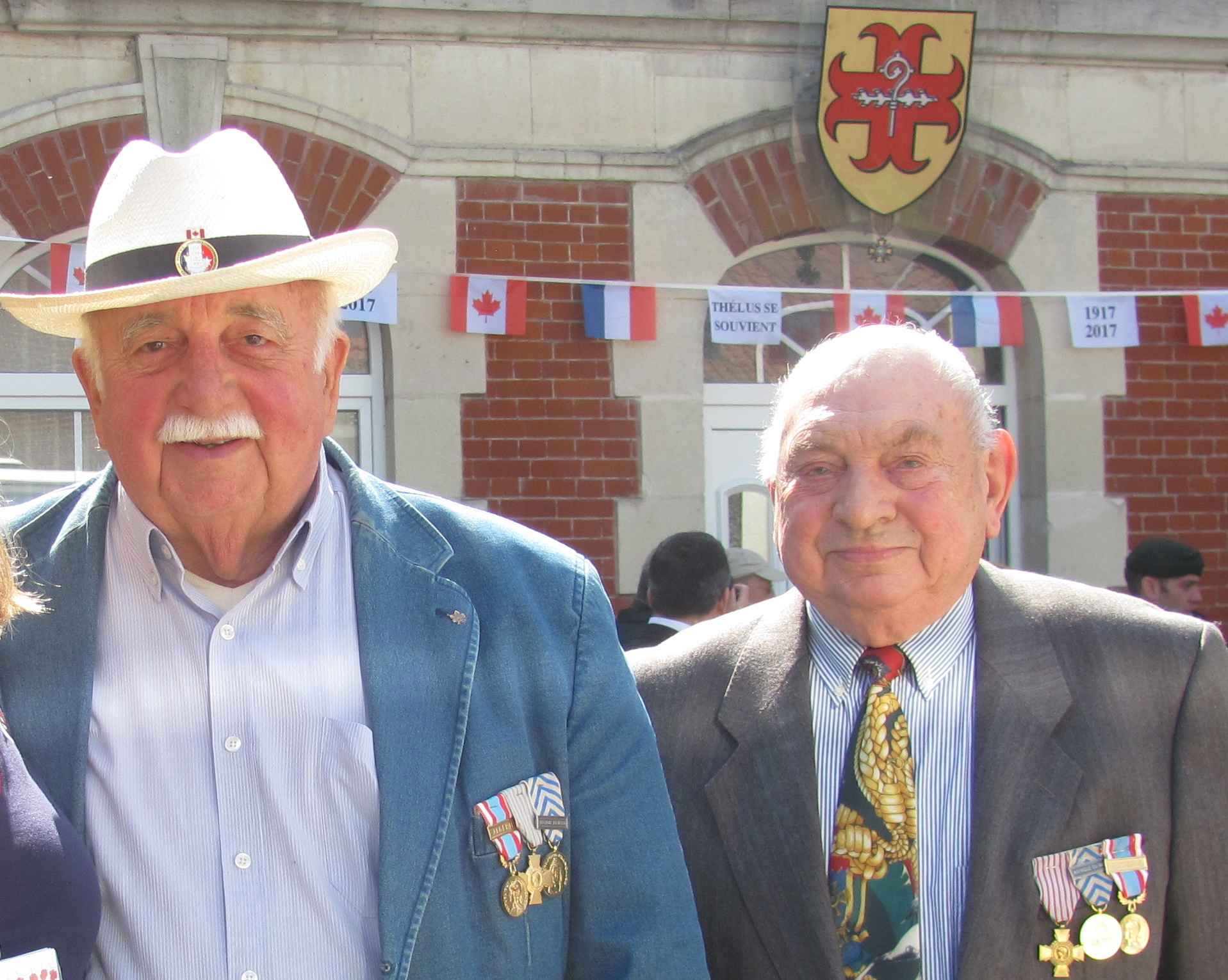 Thelusian French veterans of the Algerian war attended and mixed with Canadians guests. Thelus coat of arms can be seen in the background.