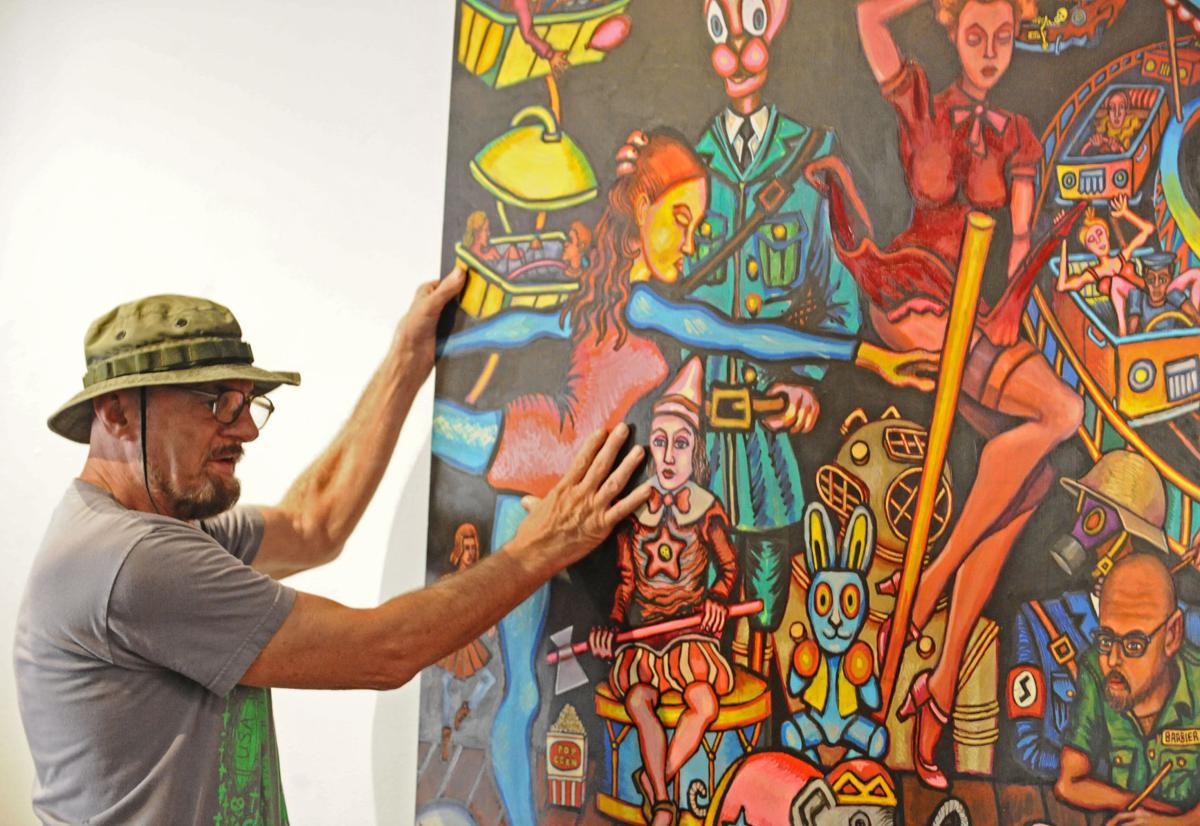 Artist Charles Barbier installing a work in a 2011 exhibition at Baton Rouge Gallery (photo courtesy of The Advocate and Heather J. McClelland)