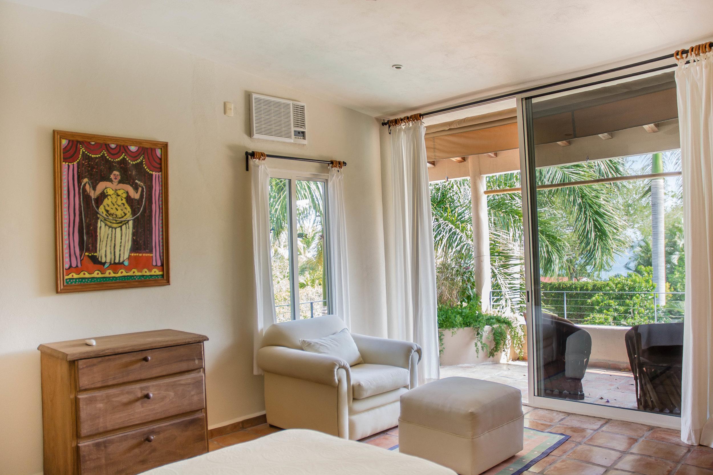 Bedroom 2, two singles, open onto deck.