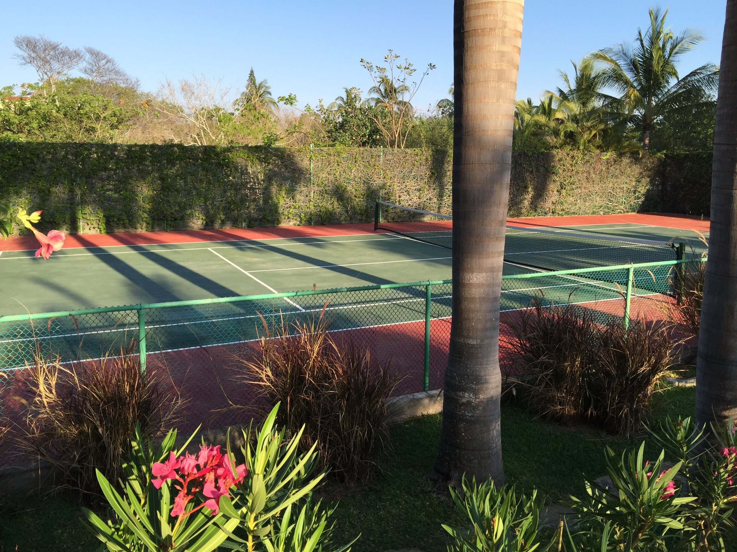 Full size tennis court.