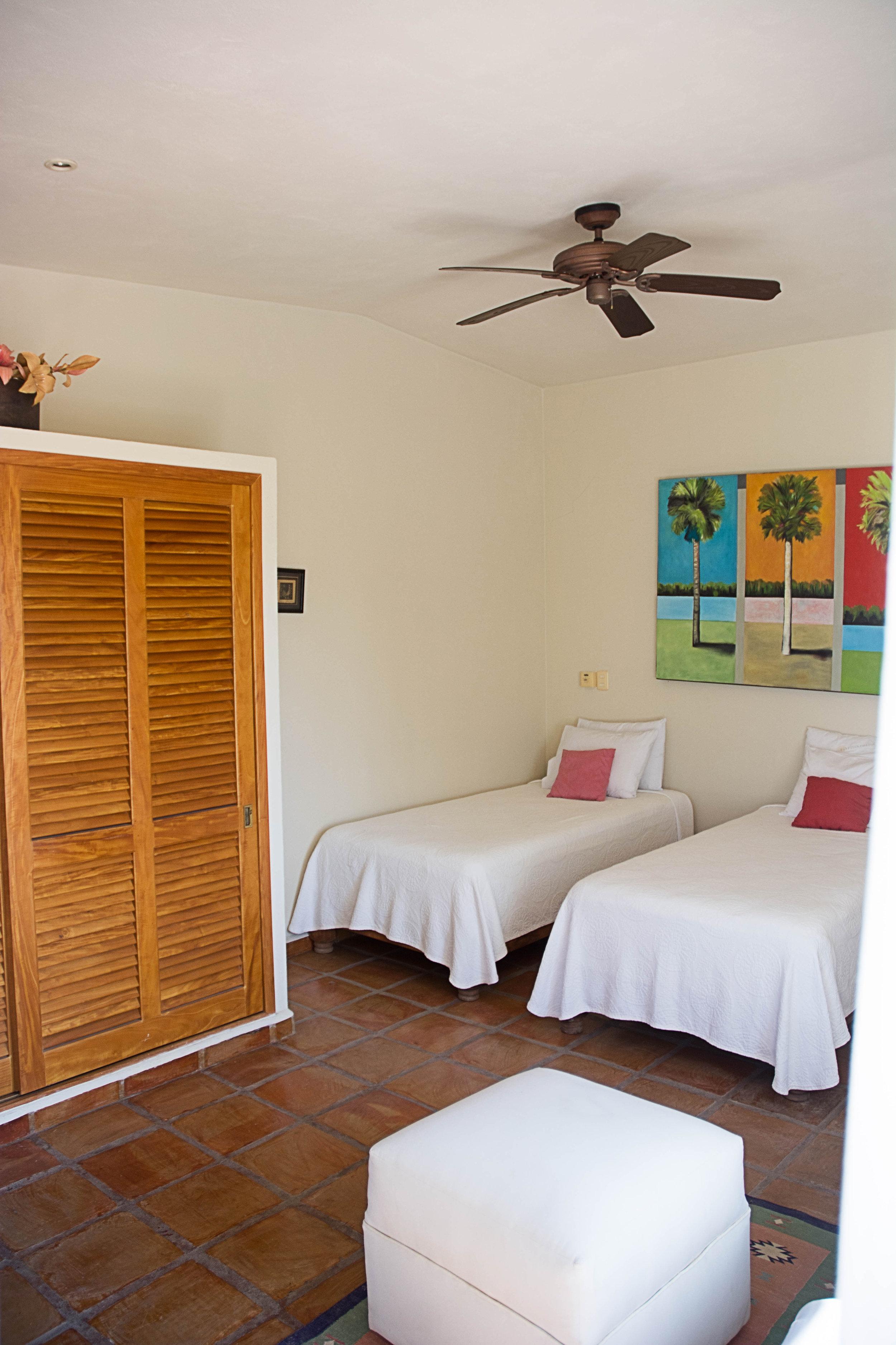 Bedroom one, two singles, open onto deck.
