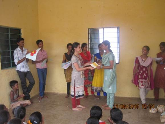 Awarding certificates to volunteers who conducted reading & math summer camp for primary school children in their village