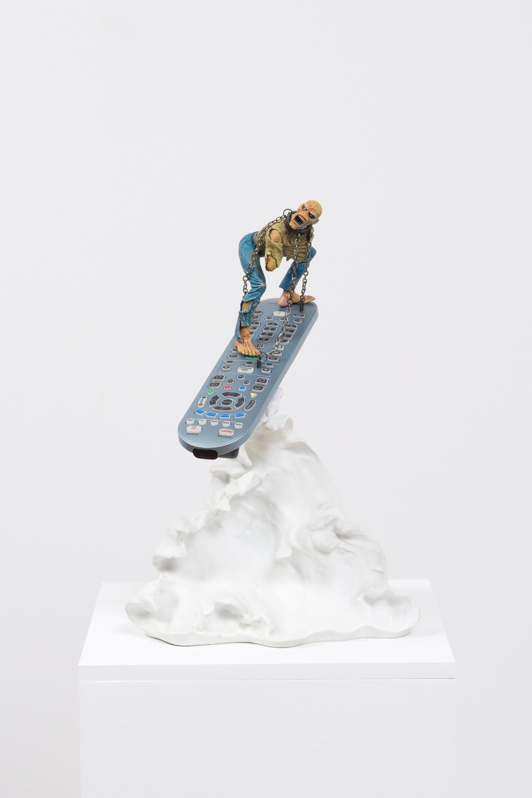 Channel Surfing, 2017  Vinyl action figure, metal chain, remote control, porcelain wave, pedestal