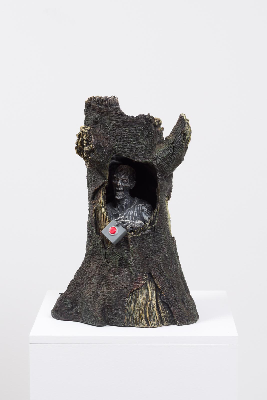 Trigger Finger, 2017  Vinyl figure, plastic weapons, resin tree, pedestal