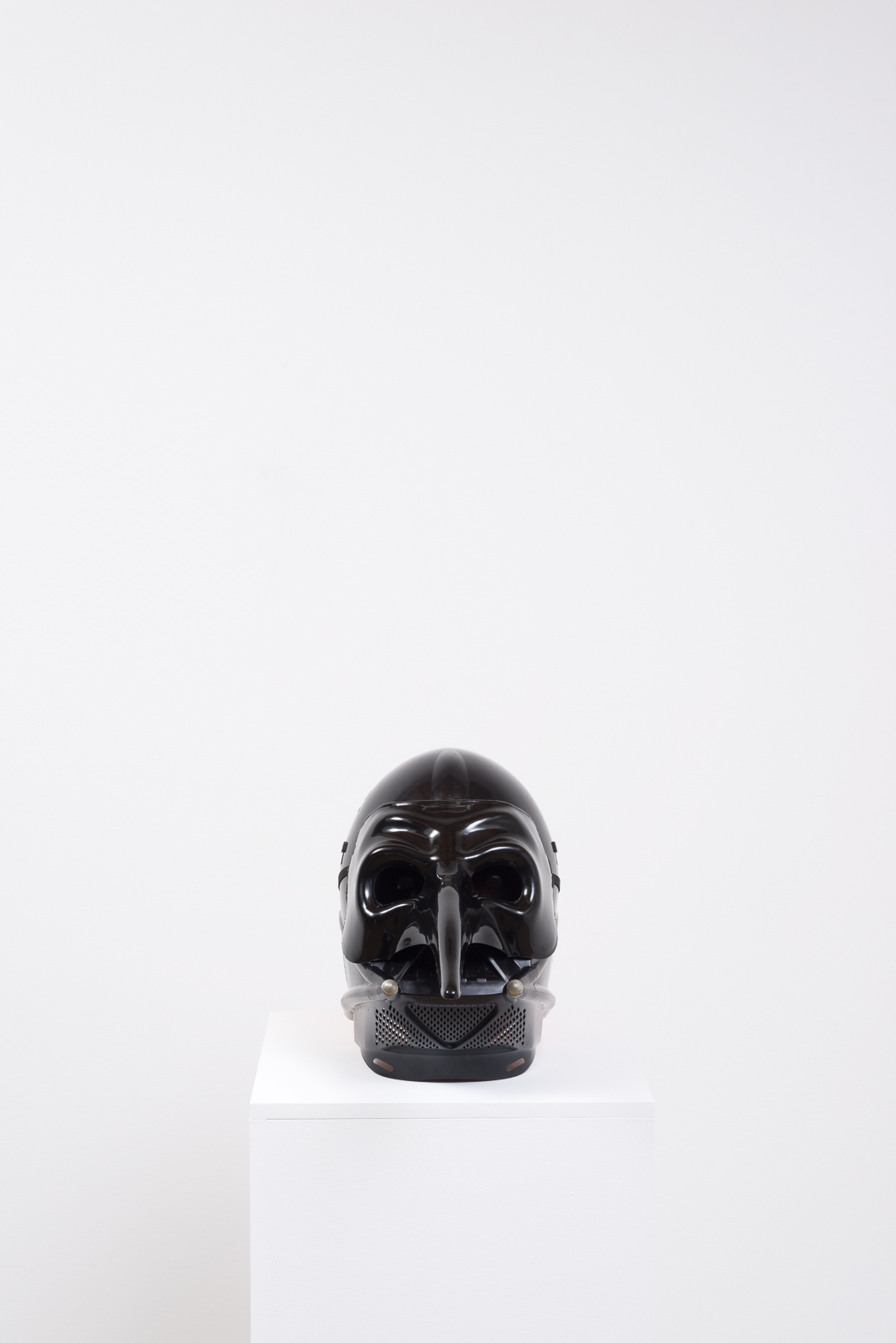 Pumpkin in a Mask in a Mask, 2017  Foam pumpkin, plastic masks, pedestal