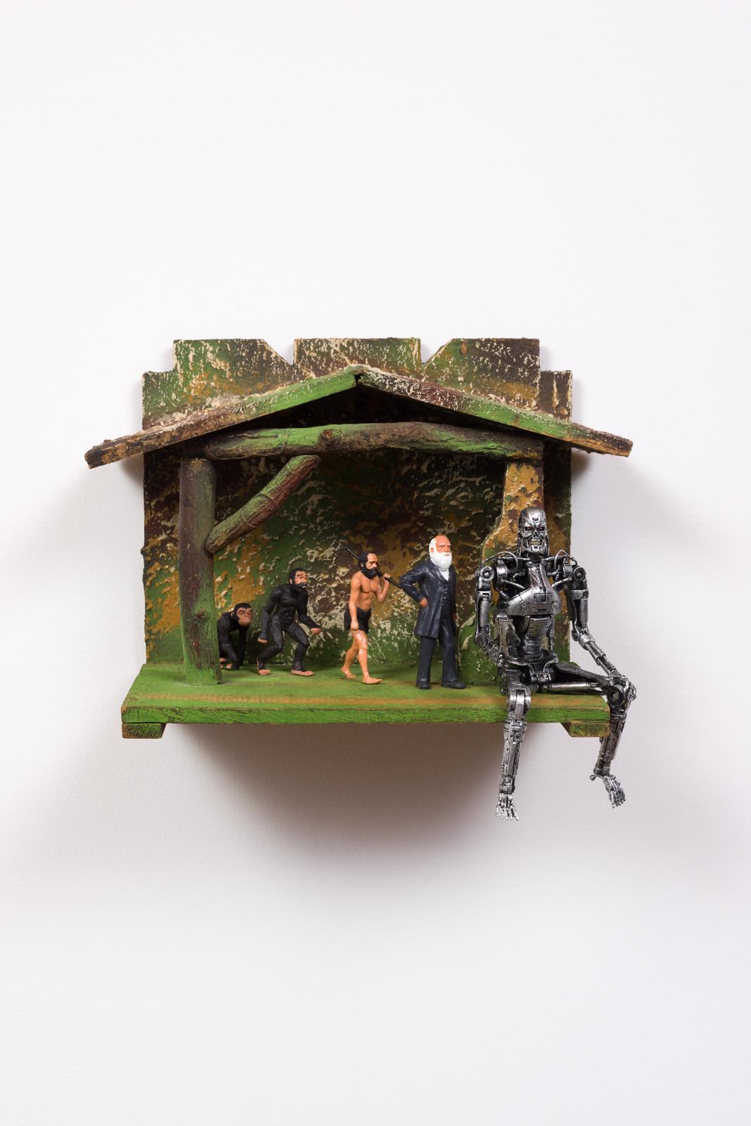 Evolution in a Manger, 2017  Plastic figures, wooden model