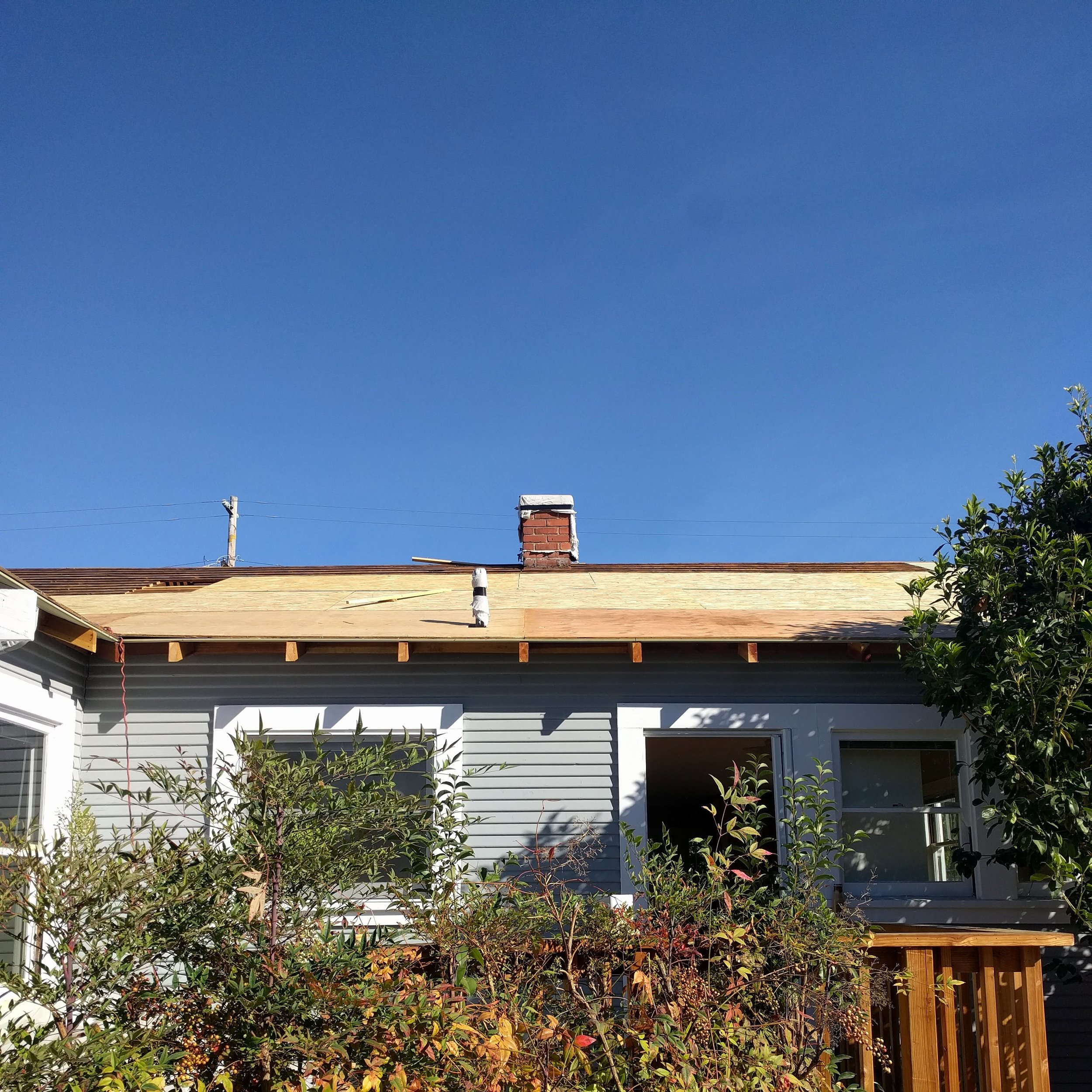 """The rear of the house now has new eaves and sheathing instead of """"skylights."""""""