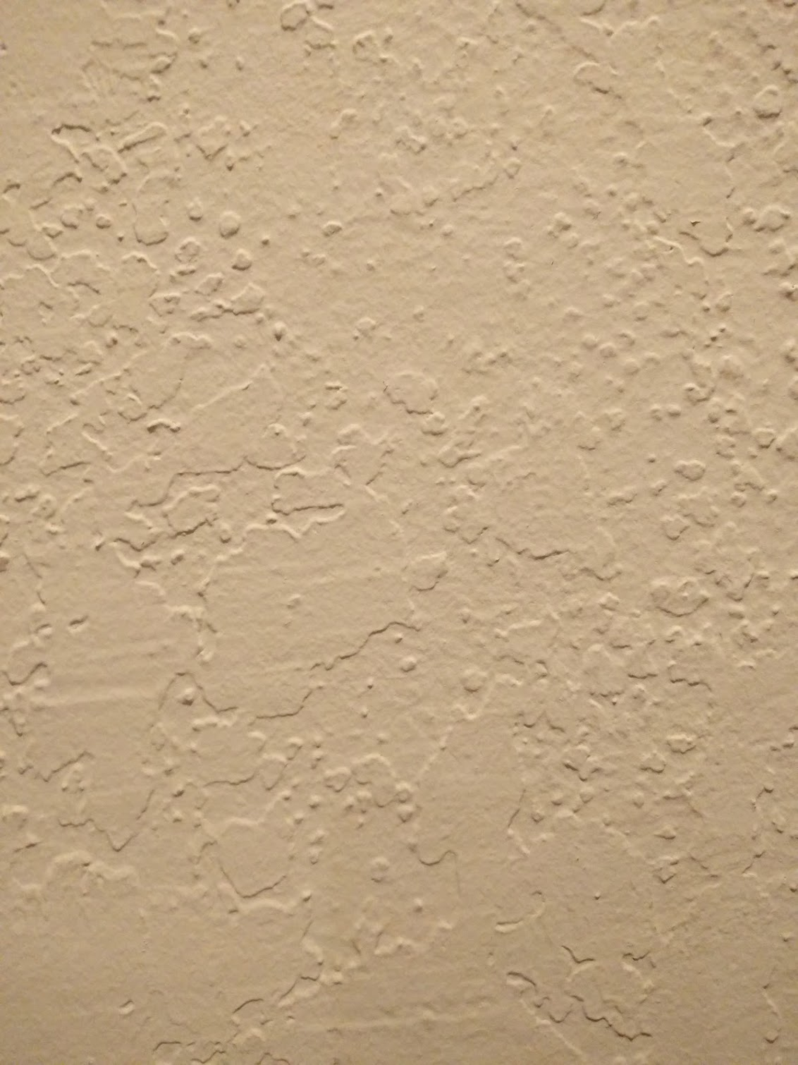 Before: textured plaster in living room