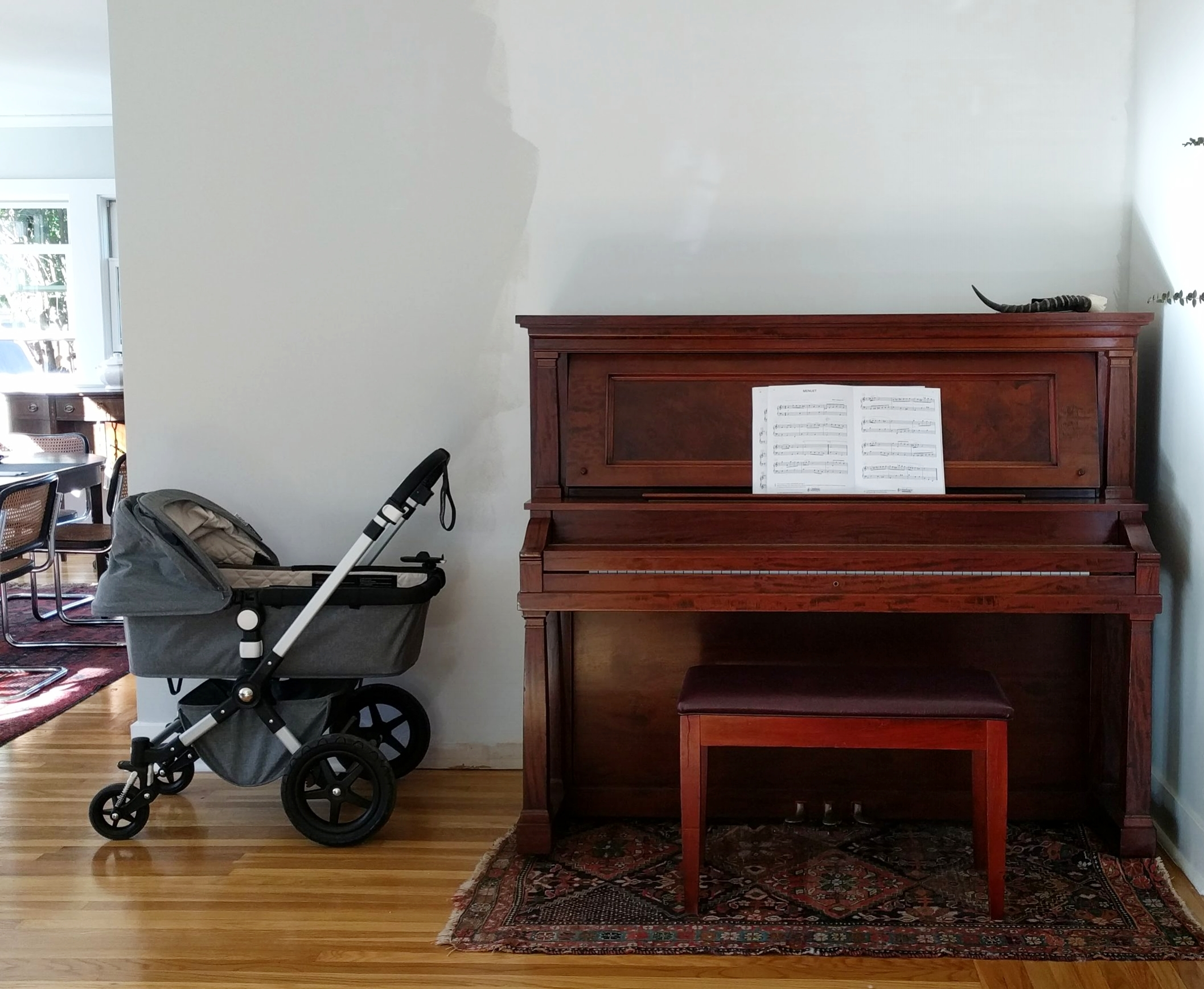Finishing the piano nook took seven weeks longer than expected: first, the lead time for the cabinets was a month longer than I thought it would be; then,the crown molding over the cabinet was delayed by three weeks. We had to hire piano movers to repeatedly move the piano in and out of this spot.