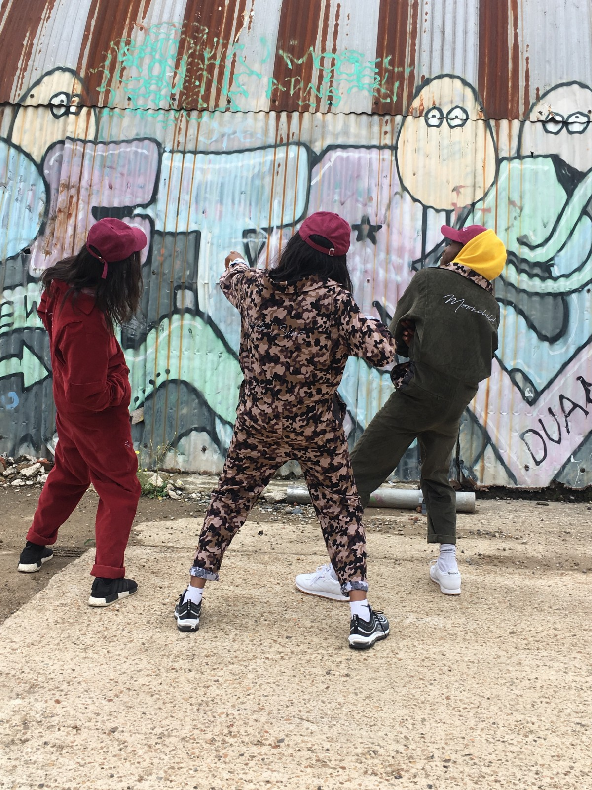 """On the set of """"Zone 3"""" music video: Josh Arcé, Little Simz and Chuck cheesin'. Tilla, Simz and Chuck modeling their customized Space Age wear jumpsuits."""