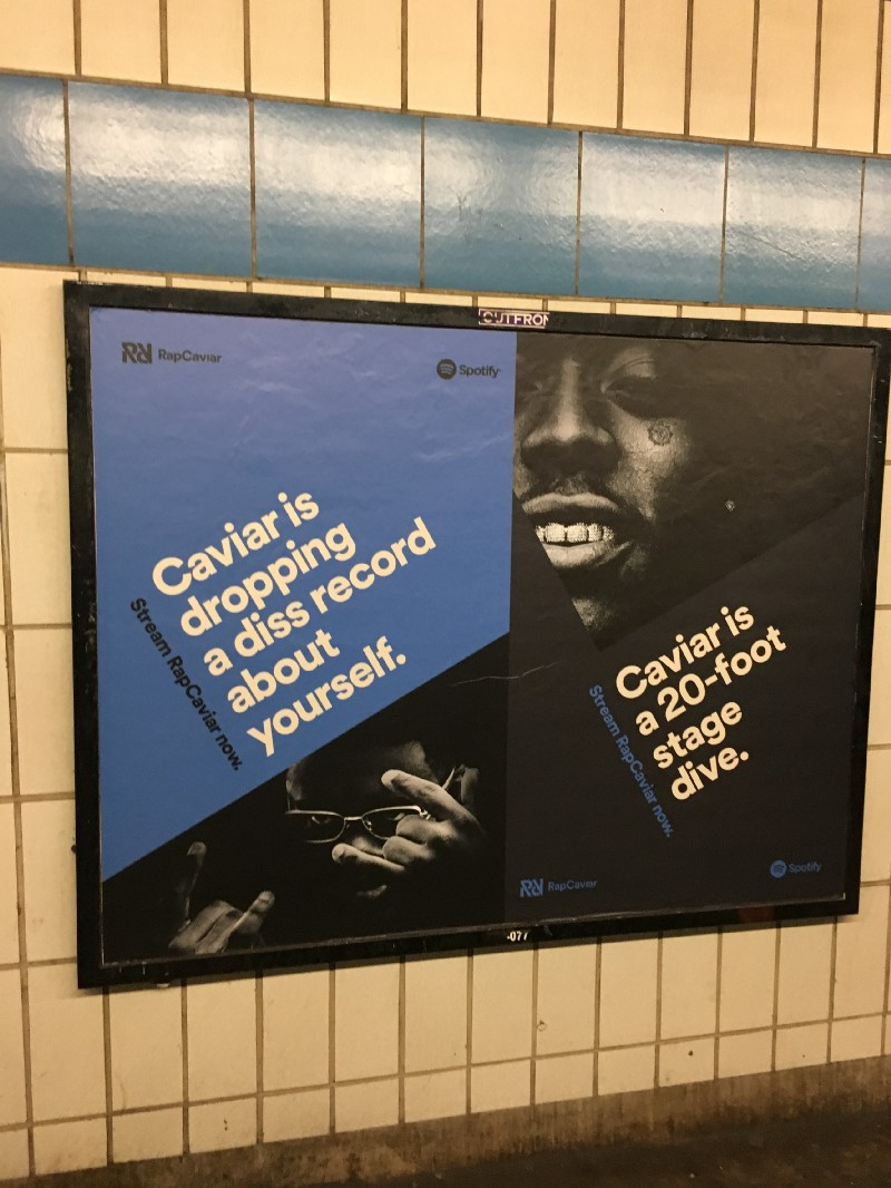 Shots from Spotify Studios in the office. A RapCaviar ad in the subway.