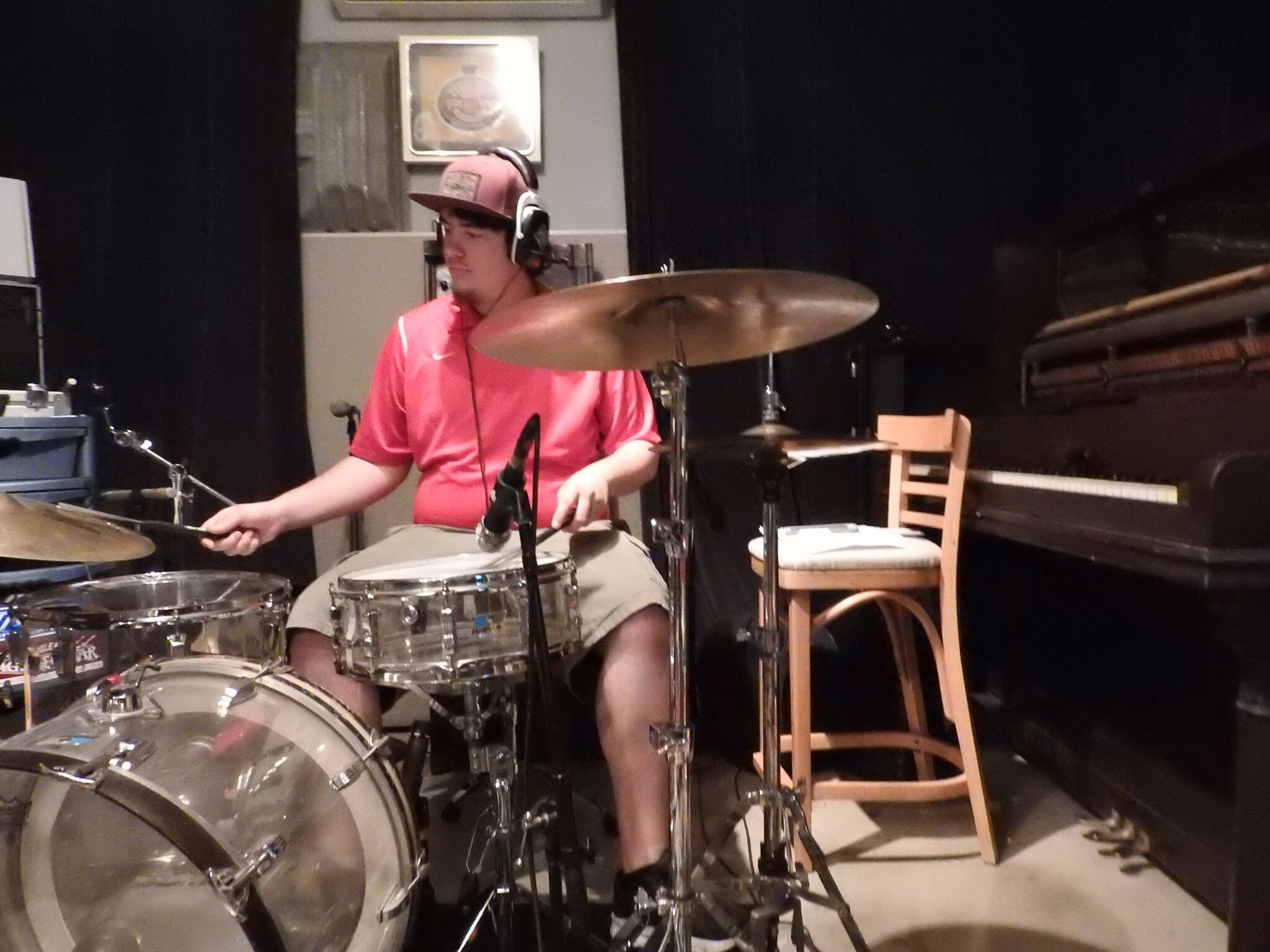 Justin Grubb, recording with Cougar Roots in Paul Beebe's Studio.