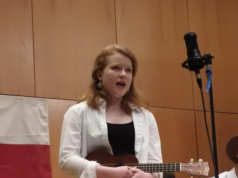 Emily Hardey performing on stage with Cougar Roots in Dudley Recital Hall.