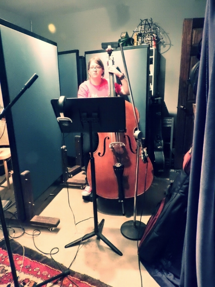 Kyrie Bouressa recording with Cougar Roots in Paul Beebe's Studio.