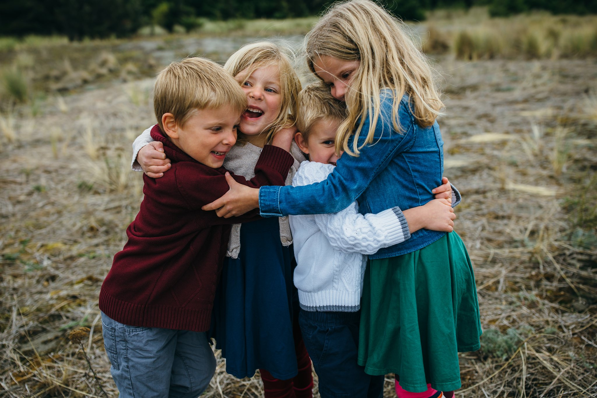 kara chappell whidbey island family photography siblings hug and laugh and deception pass state park