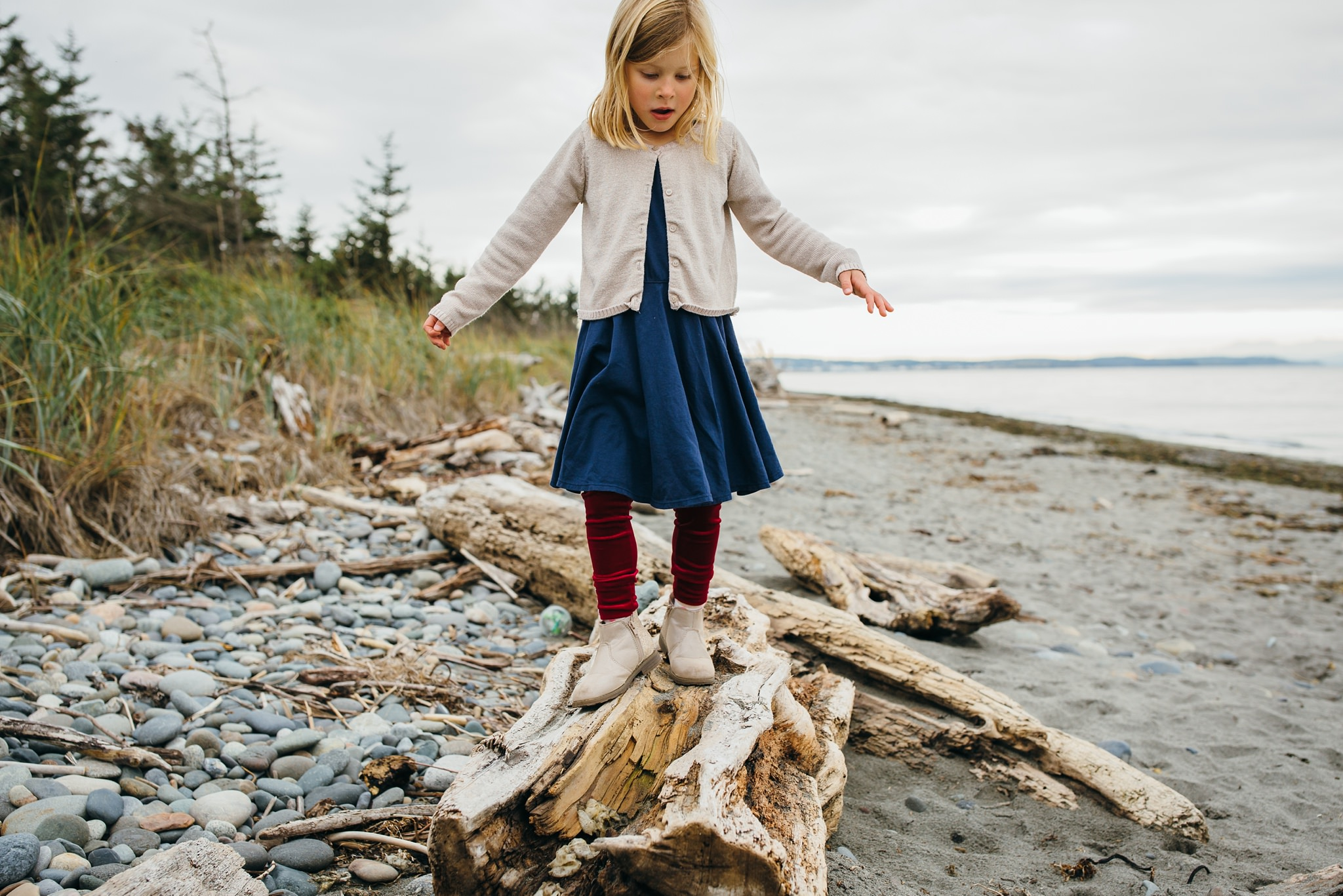 kara chappell whidbey island family photography girl balances on driftwood at deception pass state park west beach