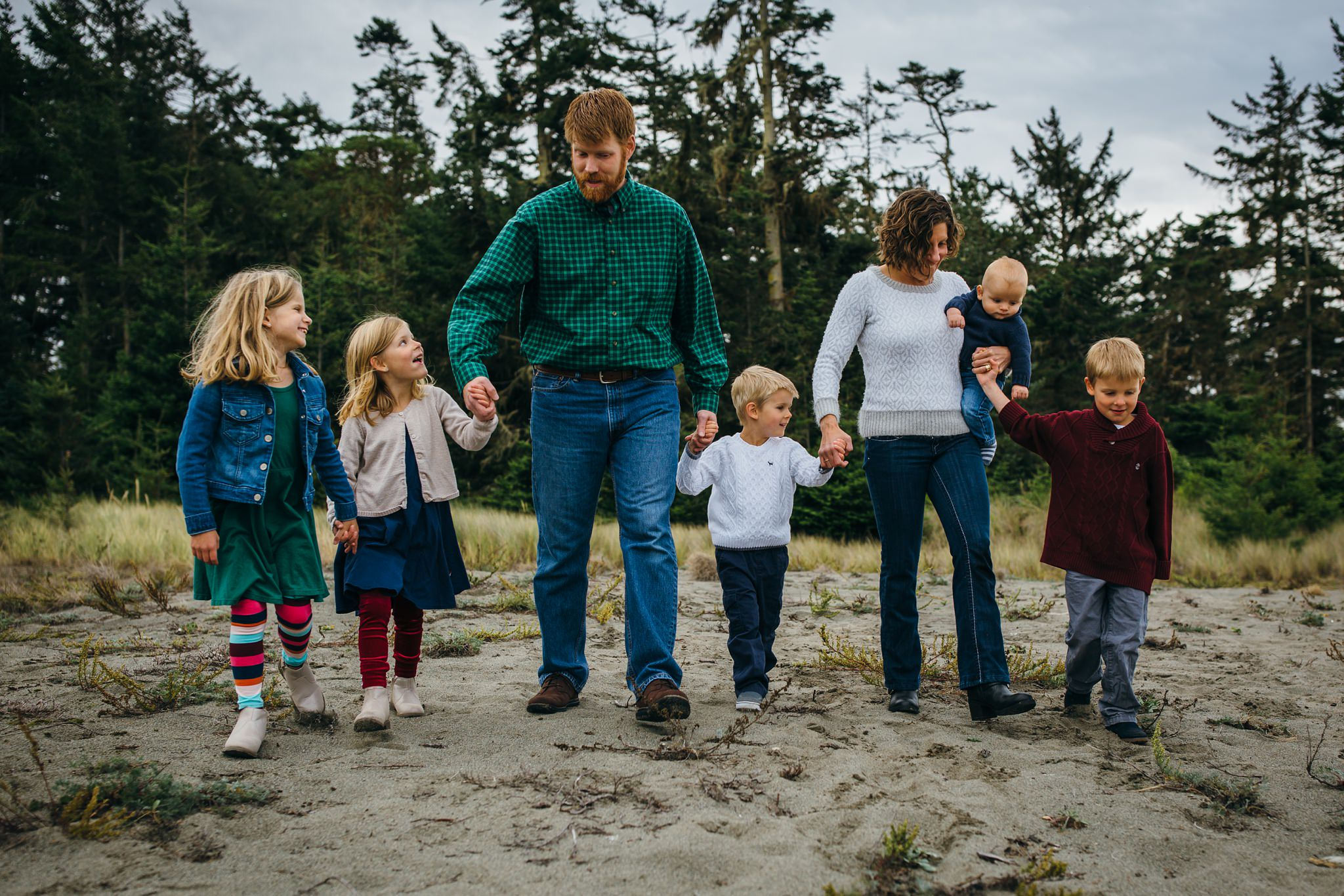 kara chappell whidbey island family photography family holding hands walking across field