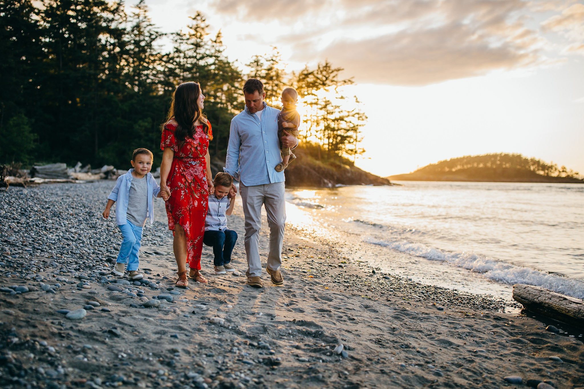 Family walks along North Beach at Deception Pass State Park