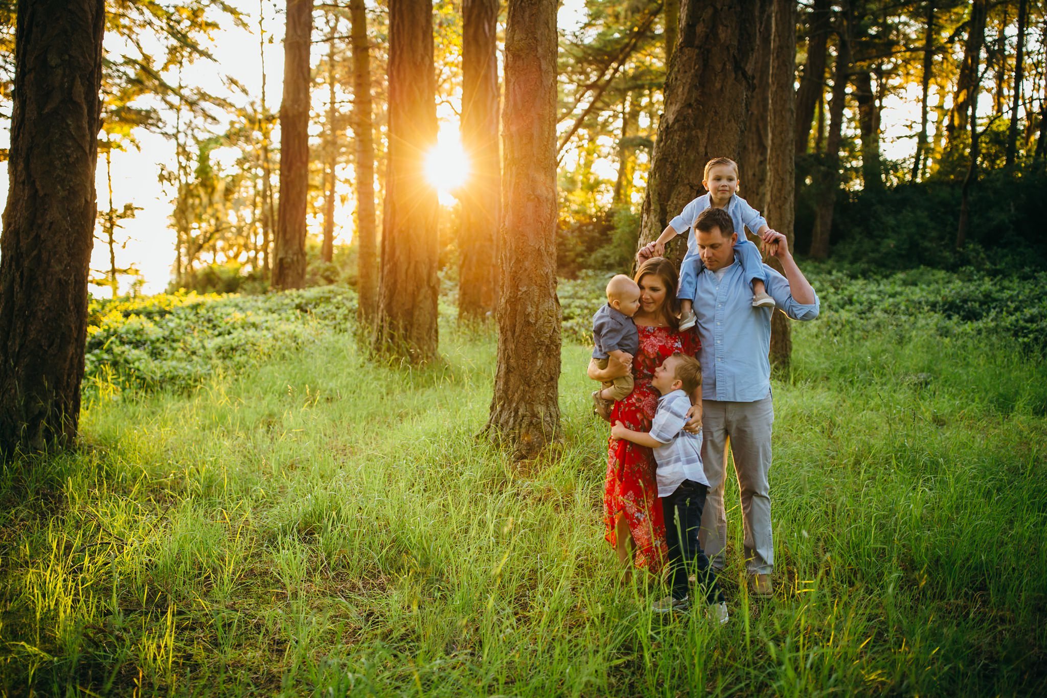 Family hugs in forest at Deception Pass | Whidbey Island Family Photographer