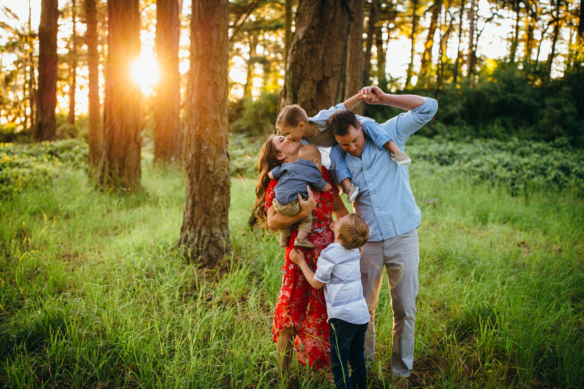 Family plays in forest | Whidbey Island Family Photographer