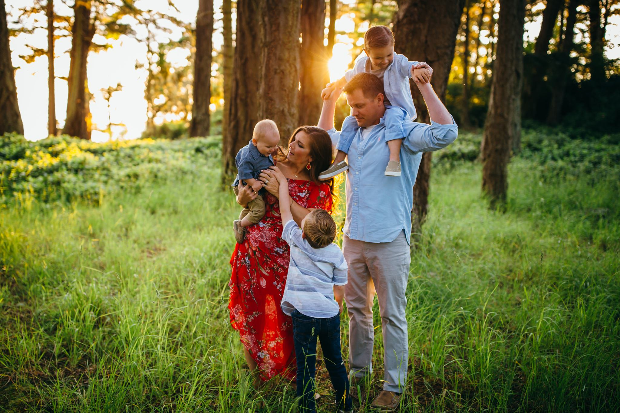 Family hugs in forest at sunset at Deception Pass State Park