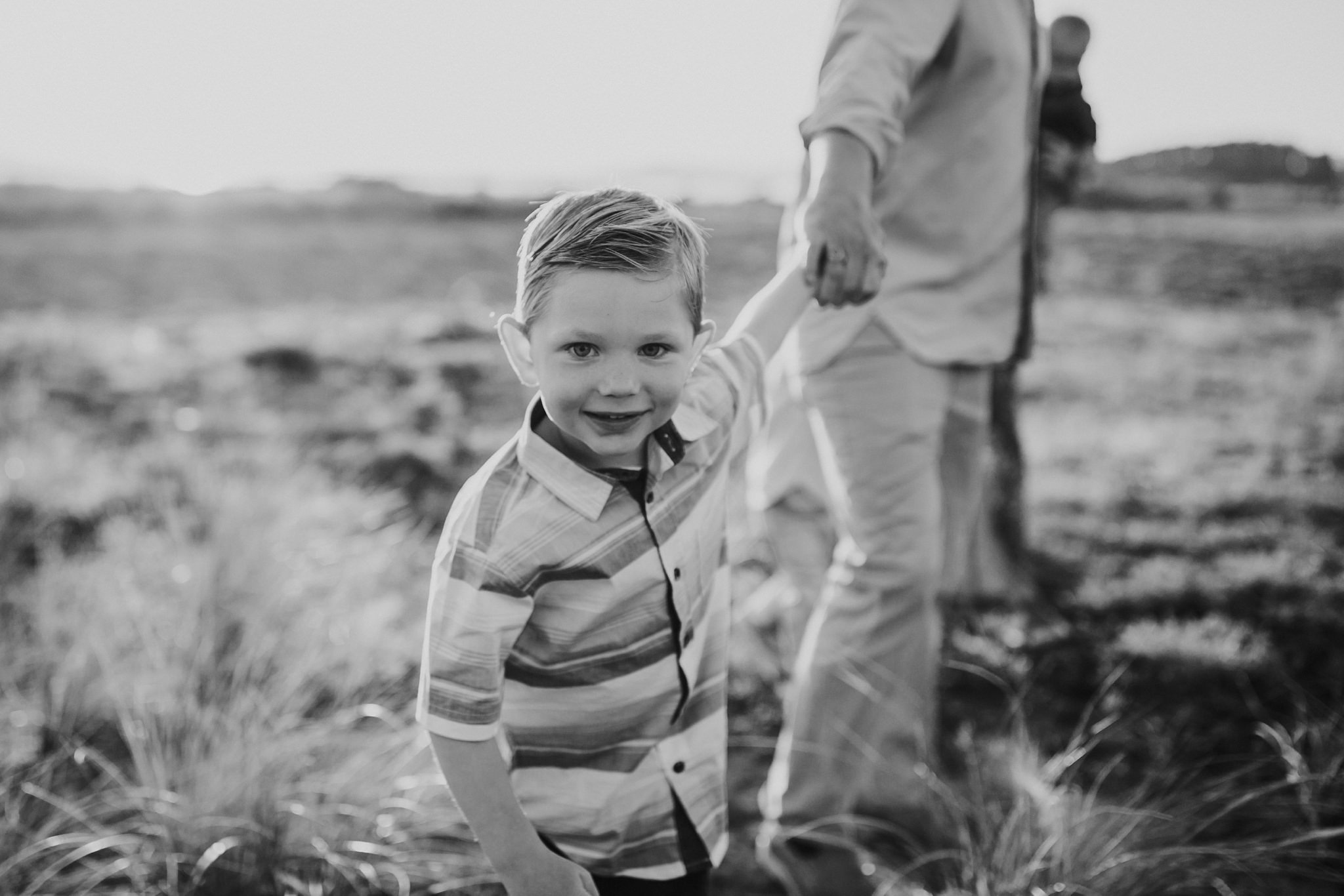 Little boy pulls dad along beach | Whidbey Island Family Photographer