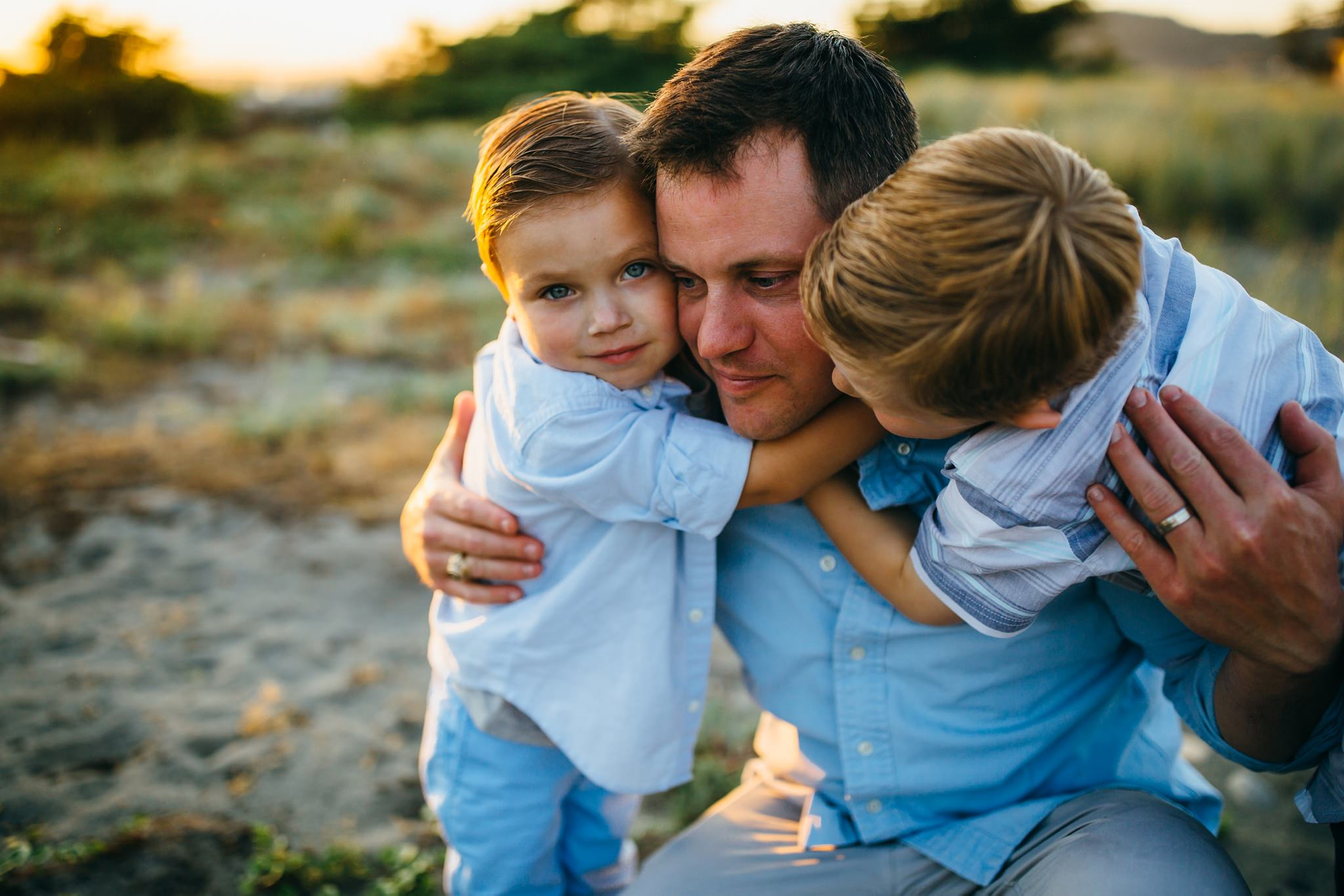 Father hugs sons | Whidbey Island Family Photographer