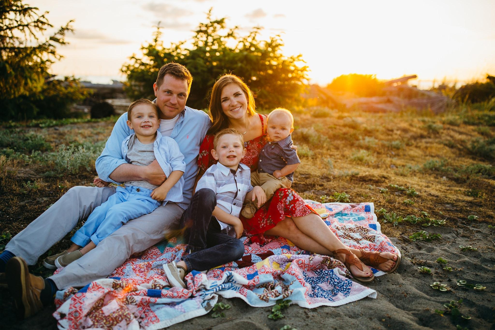 Family snuggles on blanket | Oak Harbor Family Photographer