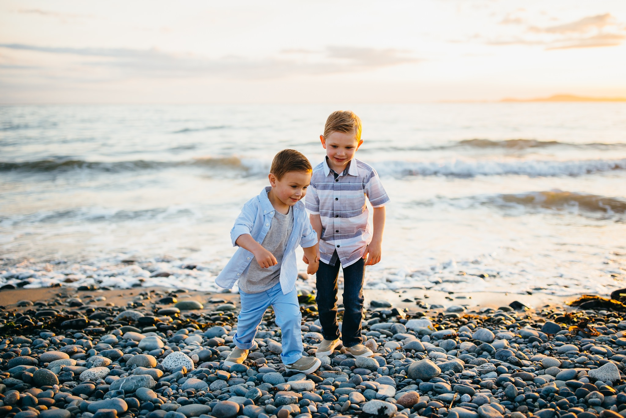 Boys run from surf at Deception Pass