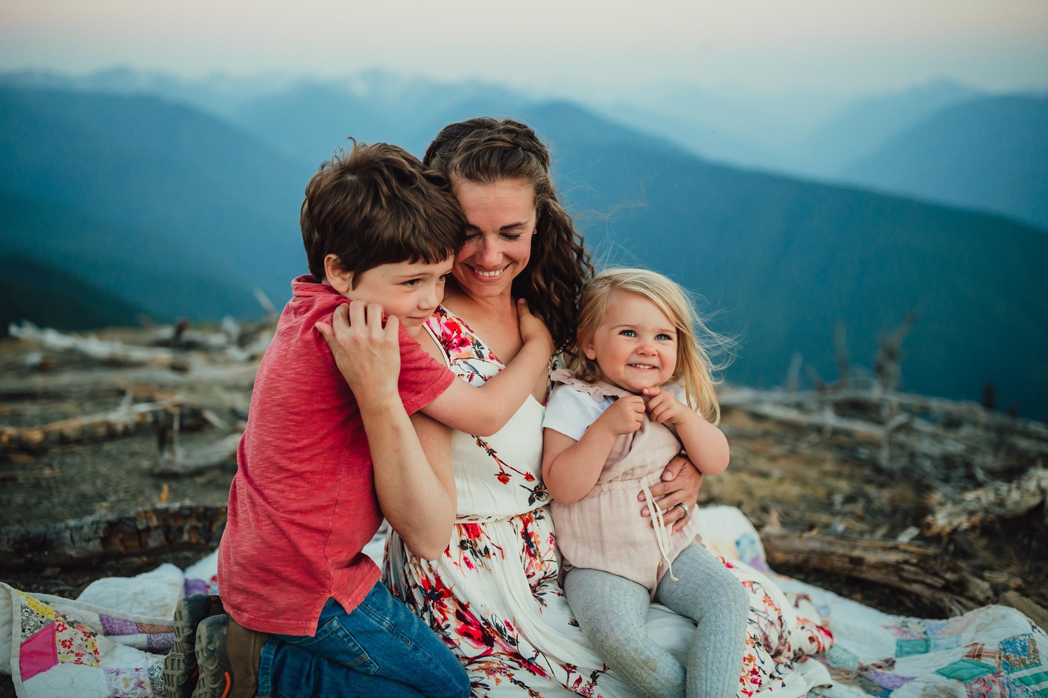 children hug mother at hurricane ridge