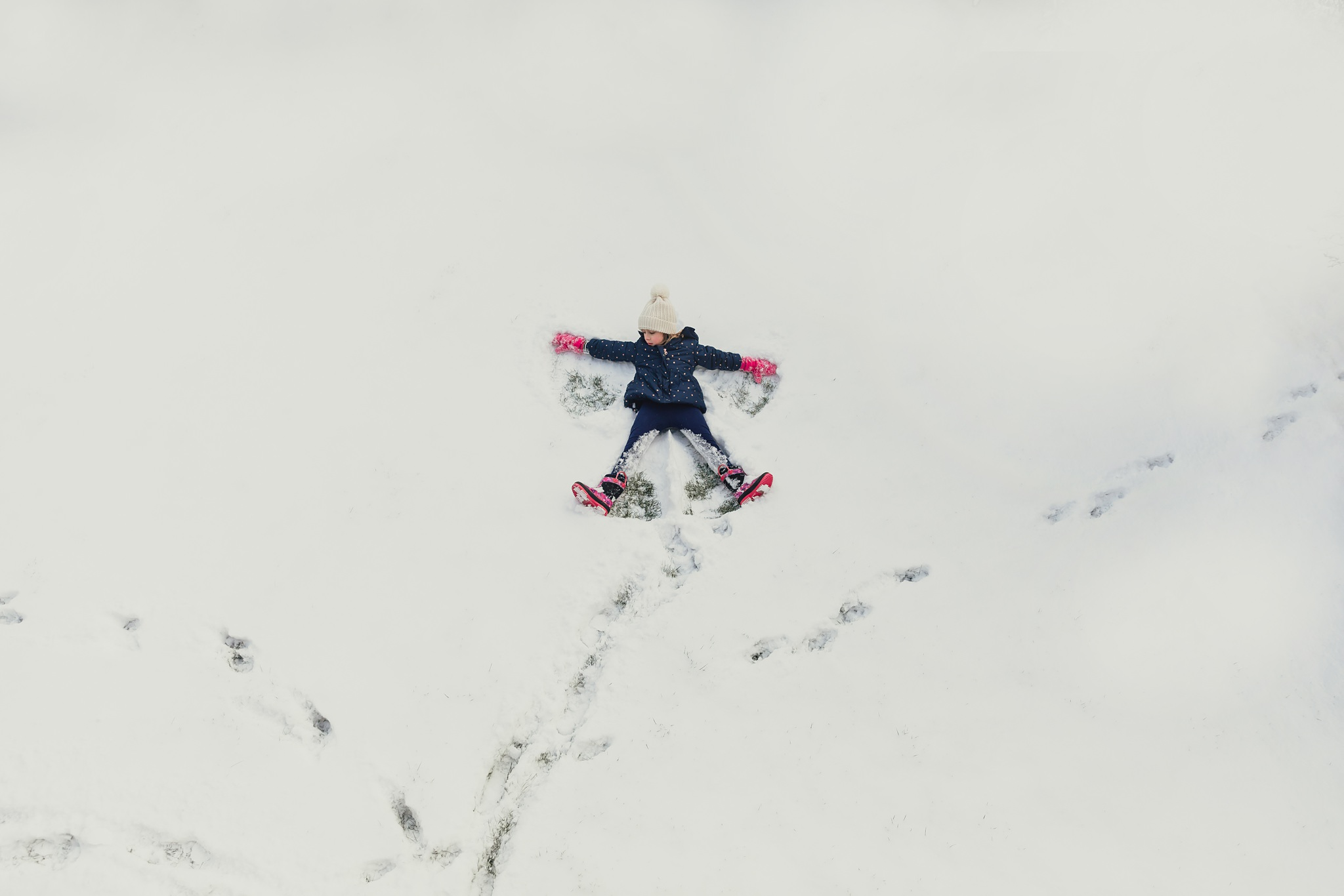 girl makes snow angel | Whidbey Island family photographer
