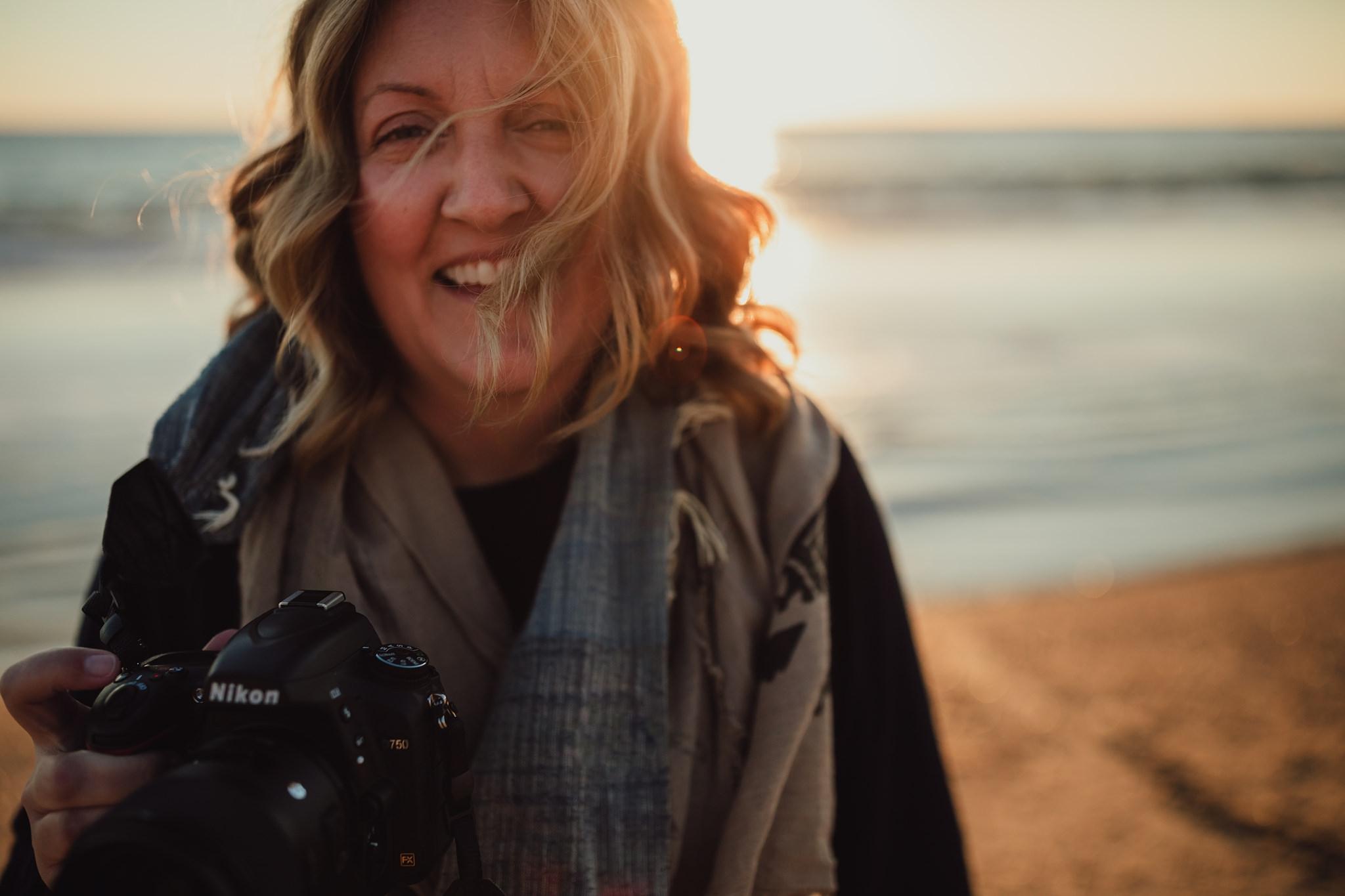 photographer laughs on Laguna beach | Whidbey Island family photographer