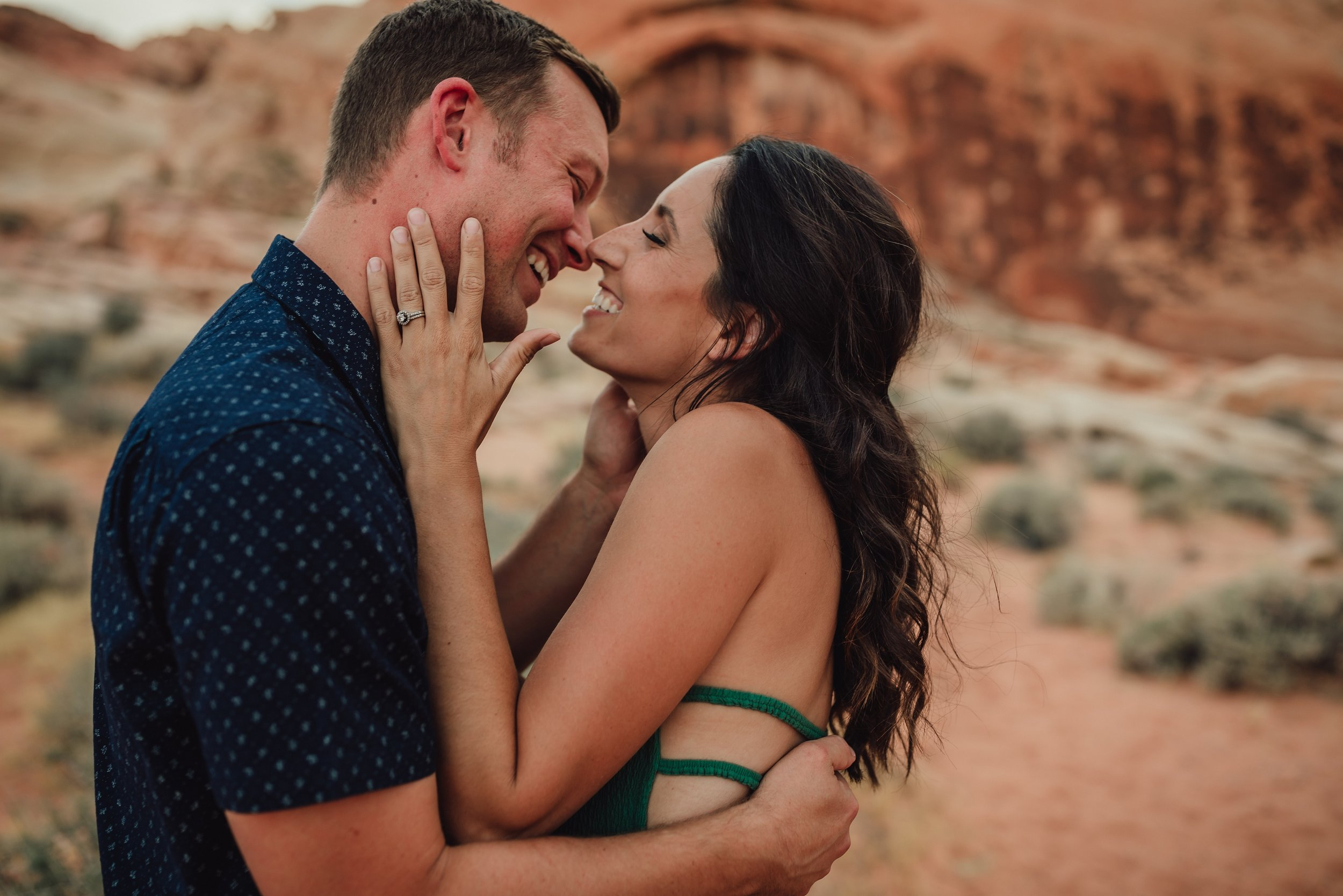 couple embrace at valley of fire state park during photo session