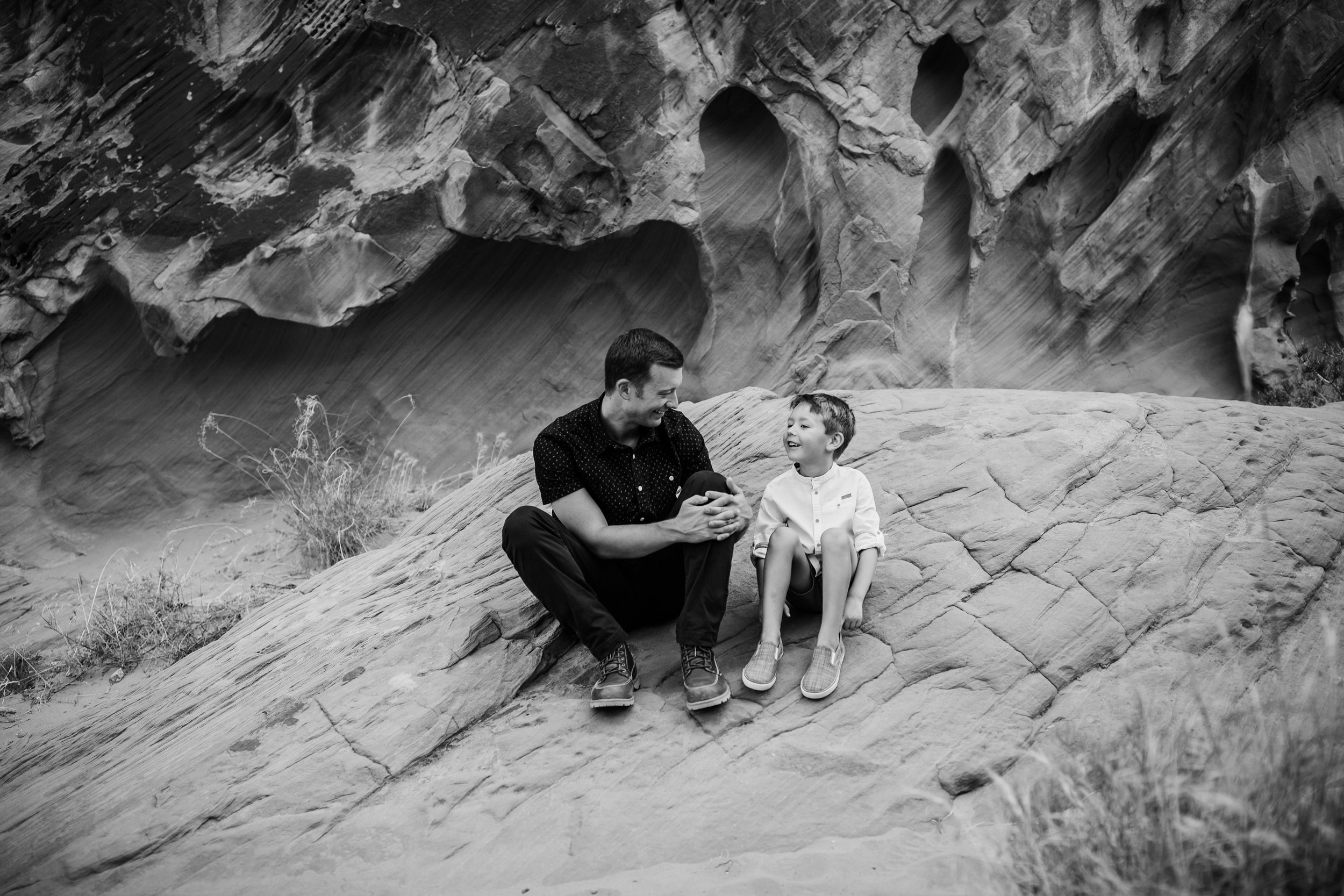 father and son talk during valley of fire photo session