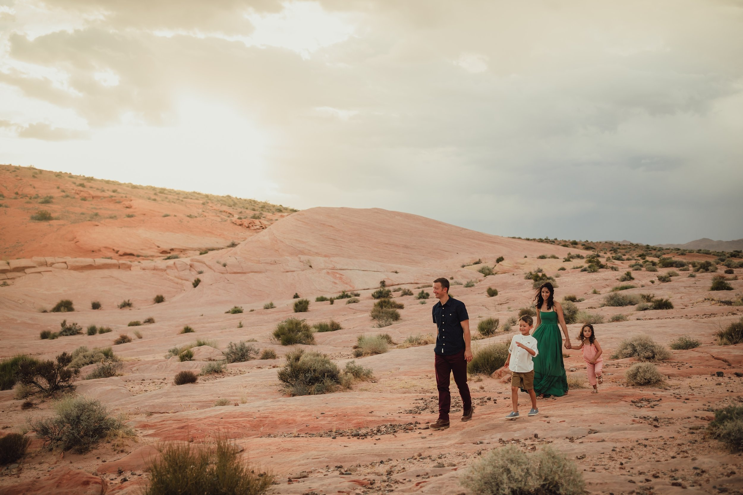 family walks through the valley of fire during photo session