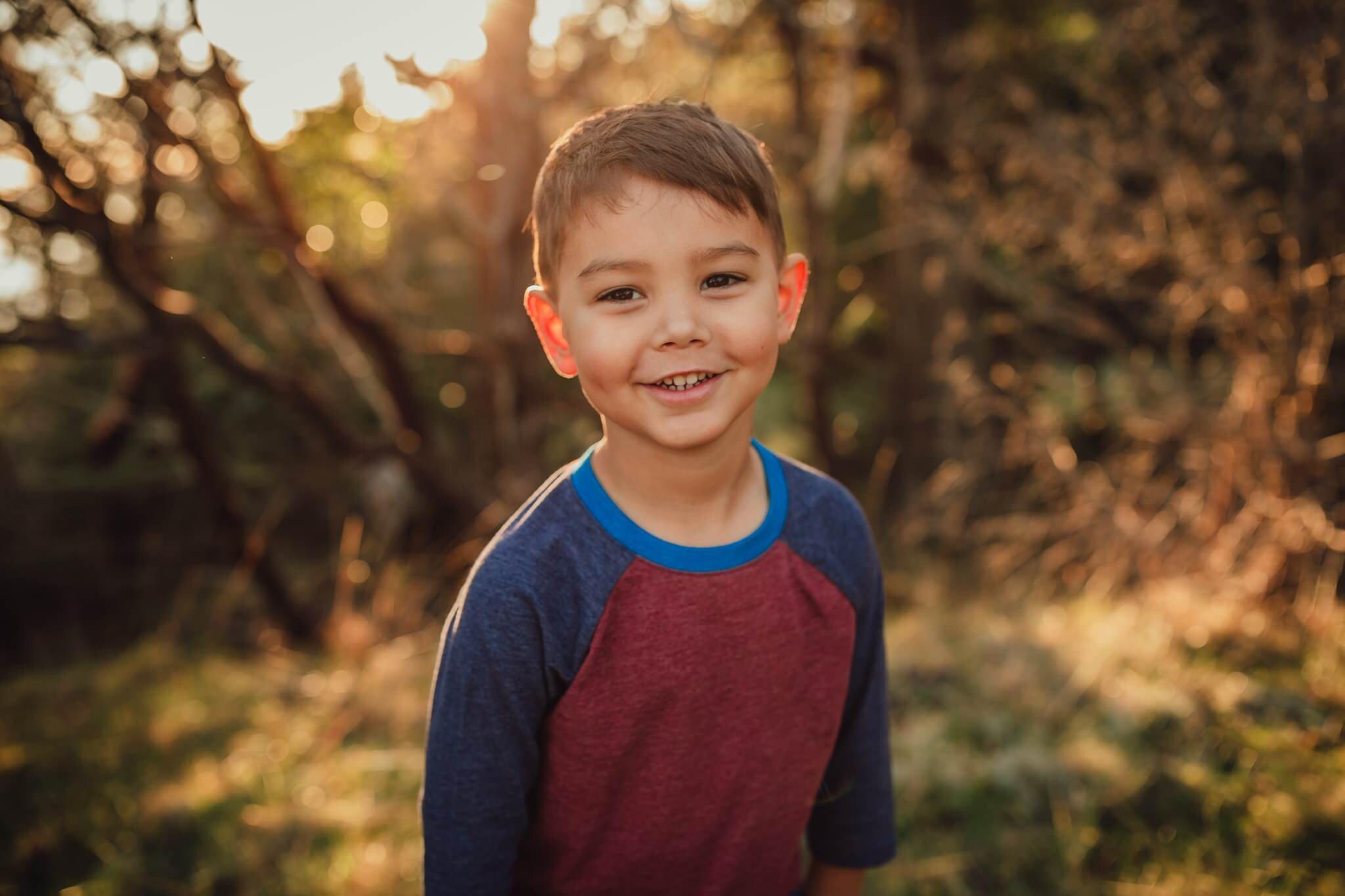 adorable boy smiles during photo shoot