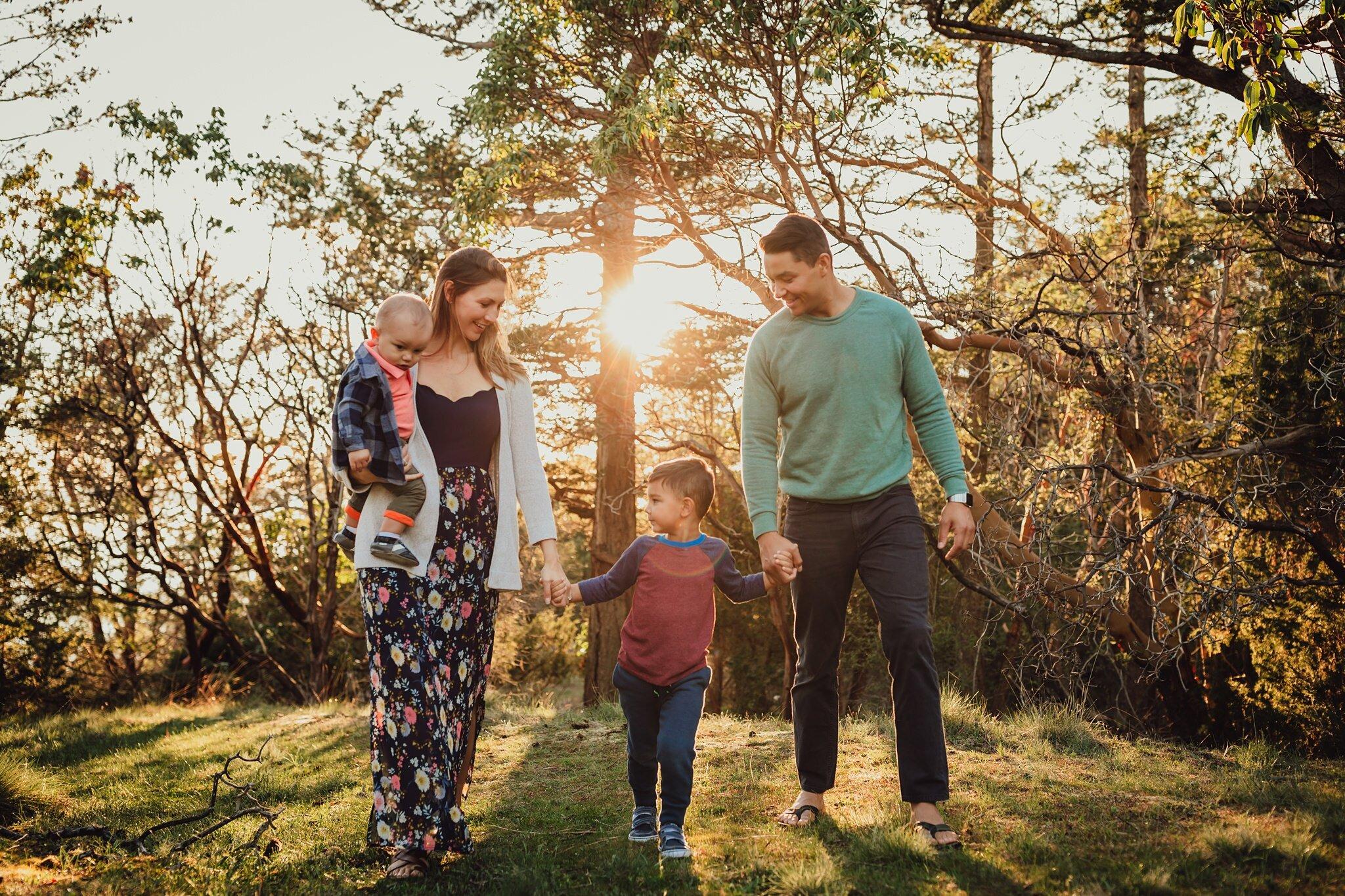 beautiful light as family walks through forest