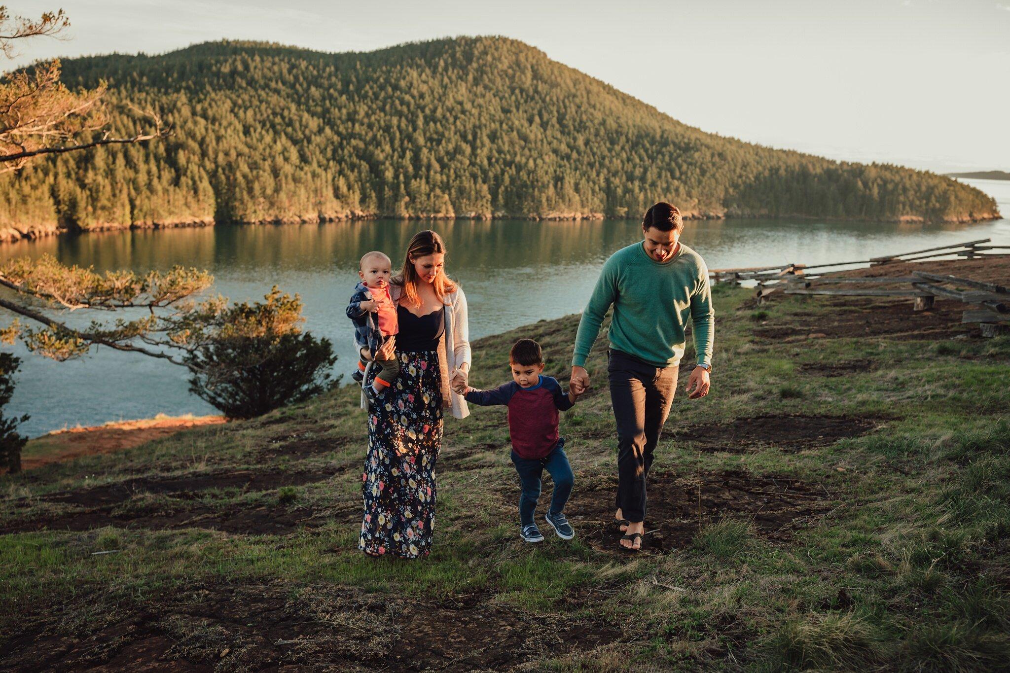 family walks up hill on Fidalgo Island