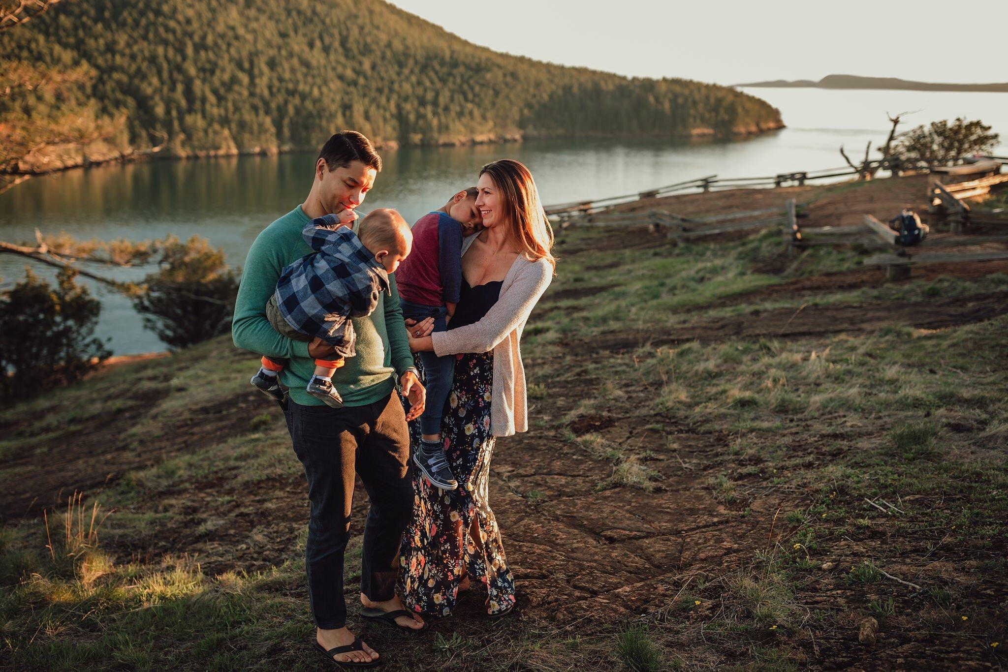beautiful family snuggles at the top of Washington Park