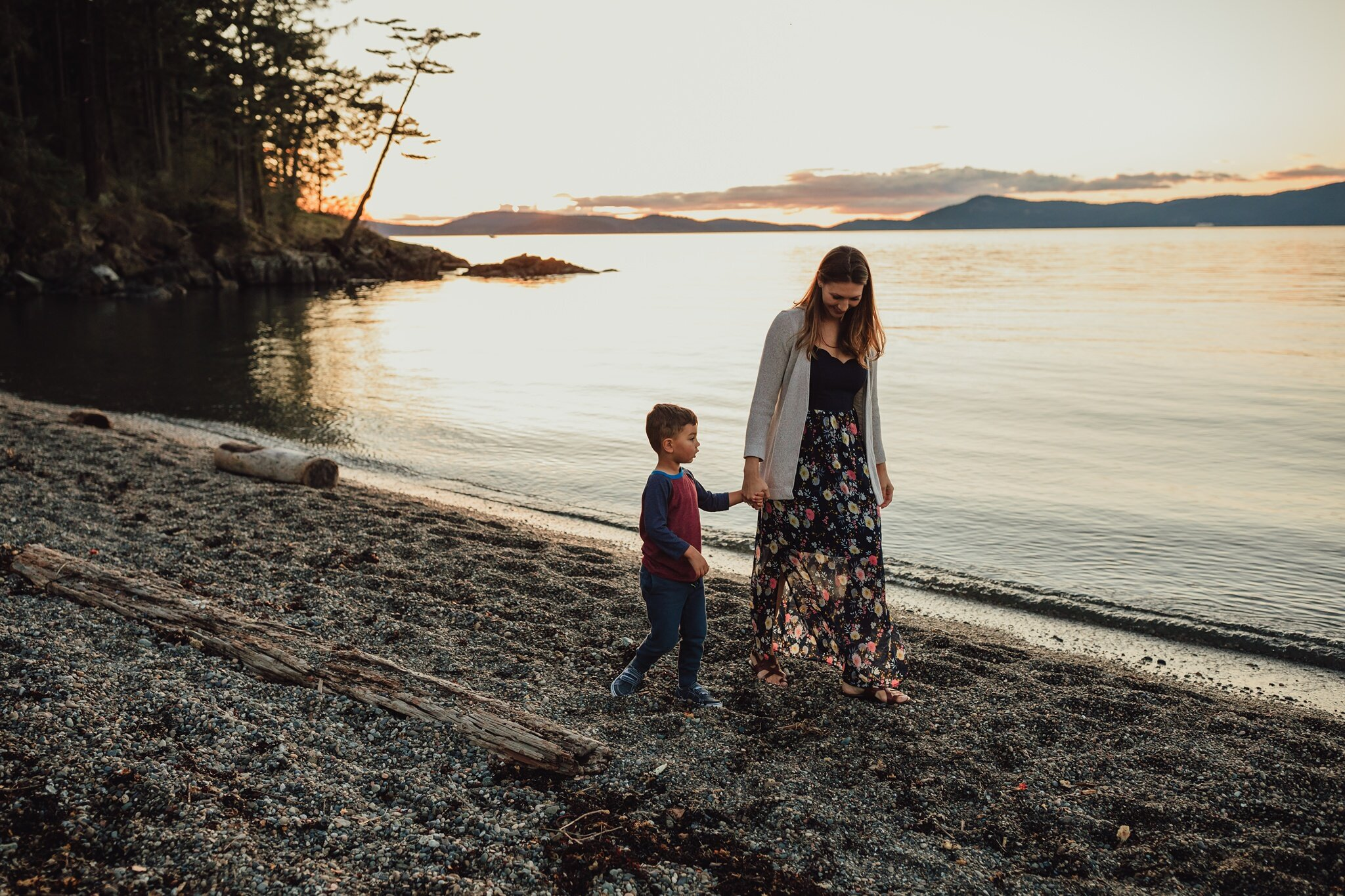 mother and son walk down beach