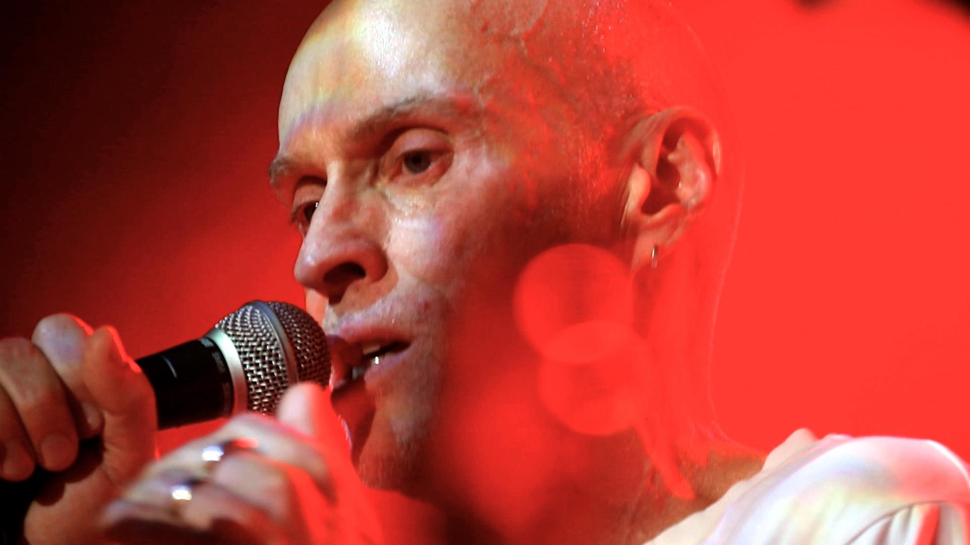 SU - stills - john singing - Version 2.jpg