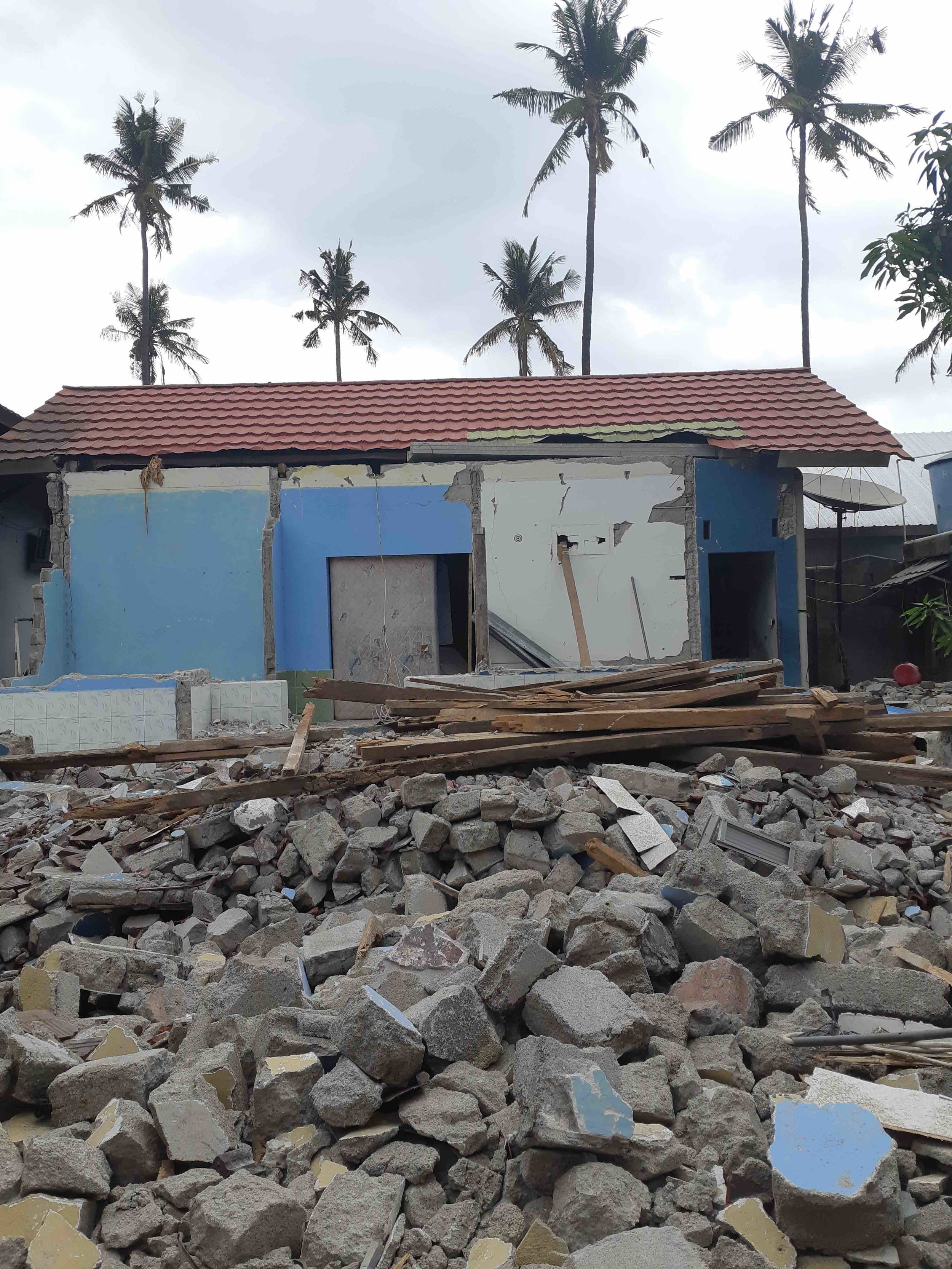 James Buchanan | Rubble remains of locals house