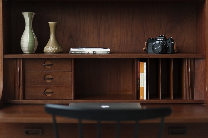 Functional vintage Danish tall secretary bookshelf by Johannes Sorth with pull out desk.